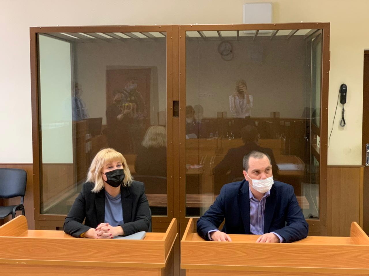 Olga Mikhailova and Vadim Kobzev, lawyers of Russian opposition leader Alexei Navalny, are seen in a courtroom before a hearing to consider an appeal against an earlier court decision that found Navalny guilty of slandering a Russian World War Two veteran, in Moscow, Russia April 29, 2021. Press Service of Babushkinsky District Court of Moscow/Handout via REUTERS