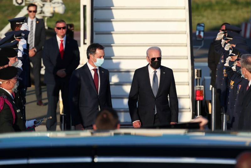 Belgium's Prime Minister Alexander De Croo welcomes U.S. President Joe Biden as he arrives ahead of a NATO summit, at Brussels Military Airport in Melsbroek, Belgium June 13, 2021. REUTERS/Yves Herman/Pool