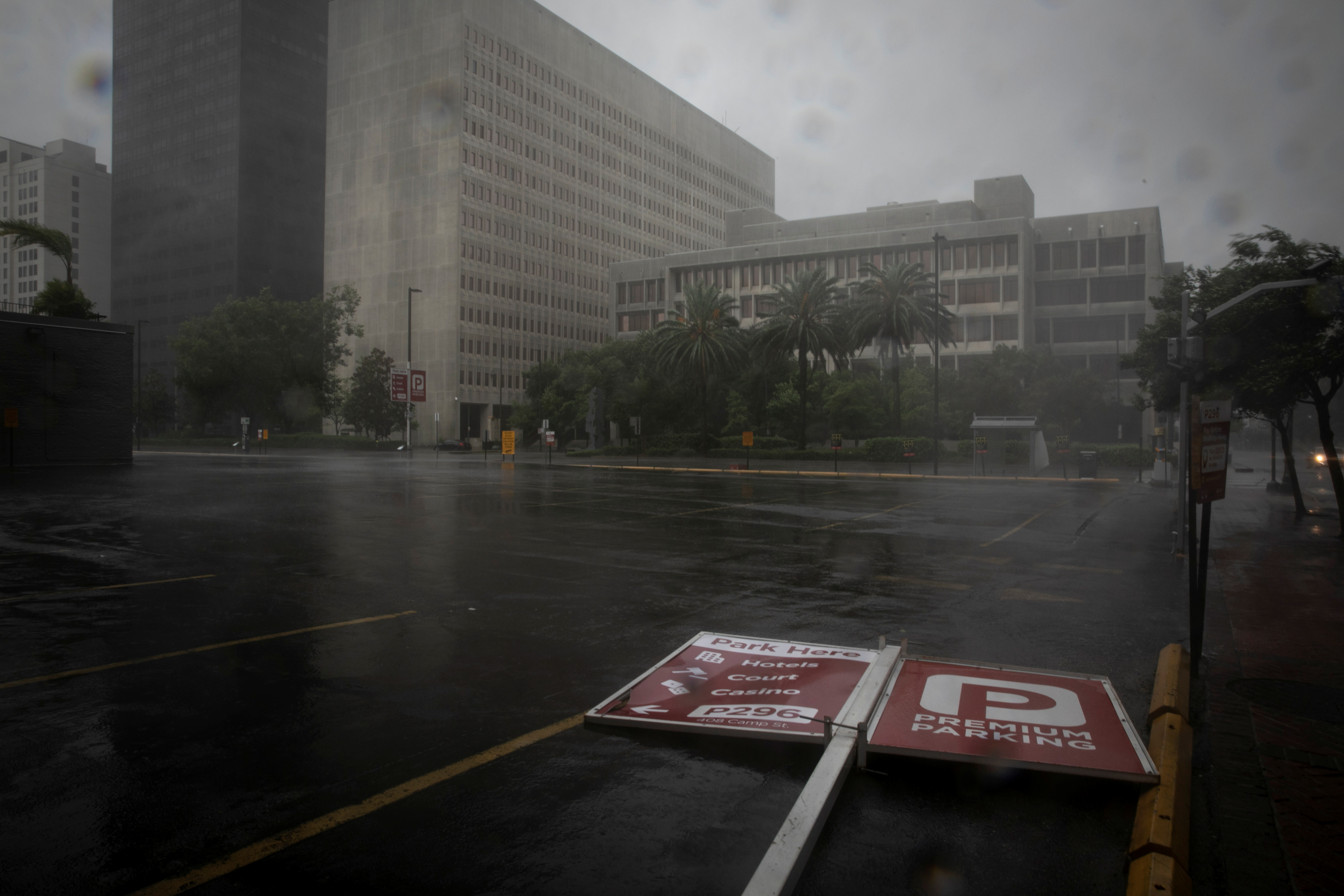 A parking sign lies in the street as Hurricane Ida makes landfall in Louisiana, in New Orleans, Louisiana, August 29, 2021. REUTERS/Marco Bello
