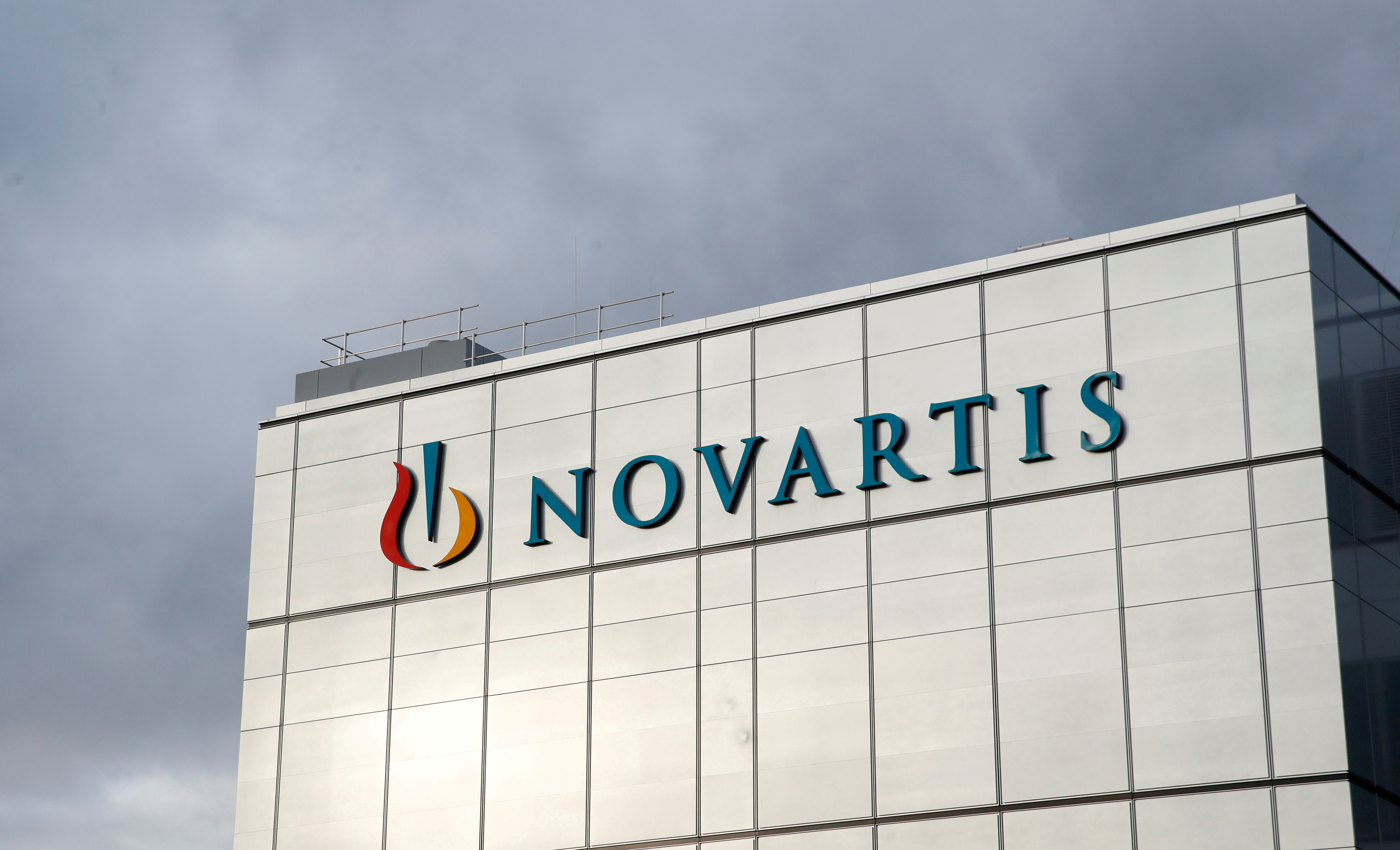 The company's logo is seen at the new cell and gene therapy factory of Swiss drugmaker Novartis in Stein, Switzerland, November 28, 2019. REUTERS/Arnd Wiegmann/File Photo