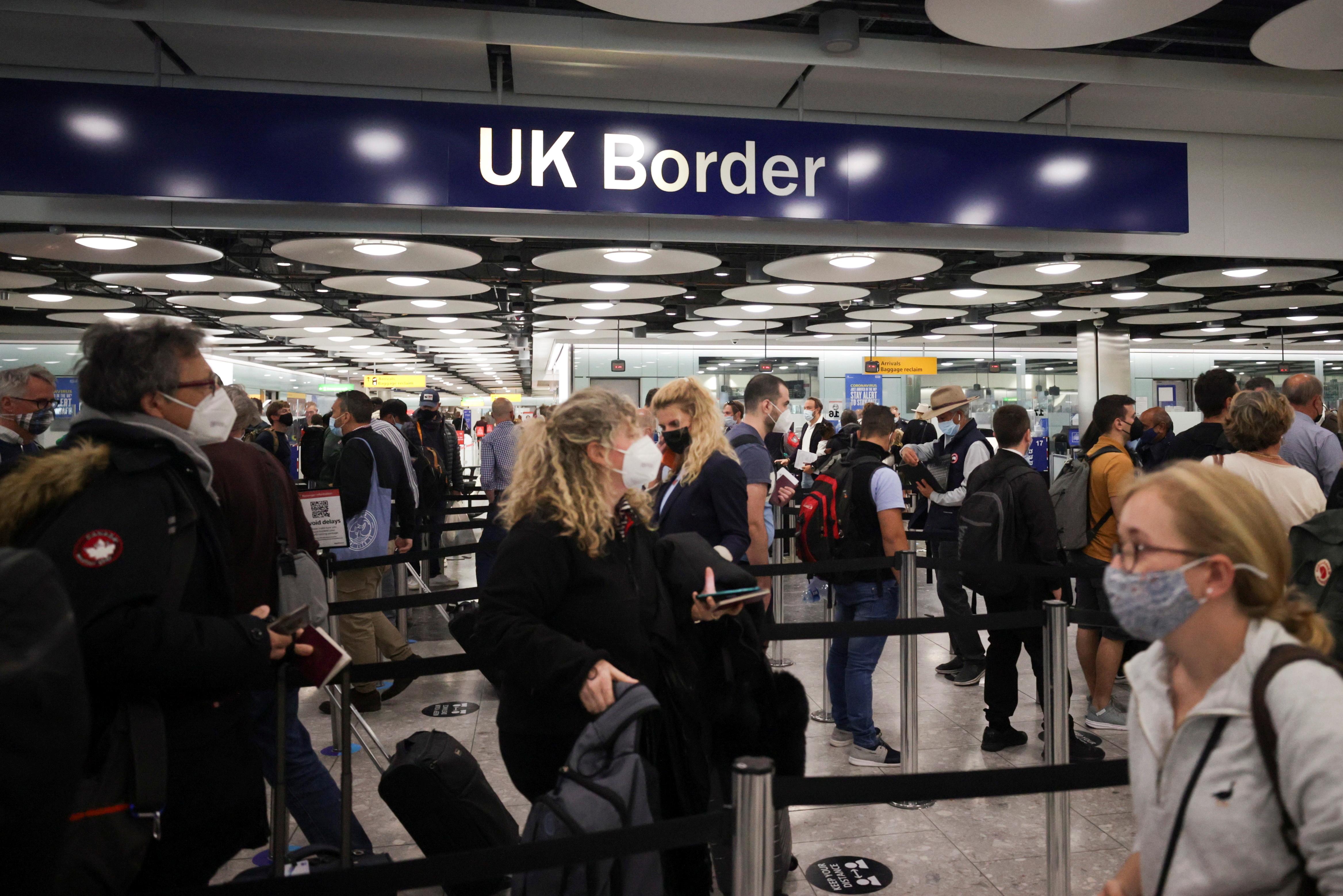 Arriving passengers queue at UK Border Control at the Terminal 5 at Heathrow Airport in London, Britain June 29, 2021. REUTERS/Hannah Mckay/File Photo