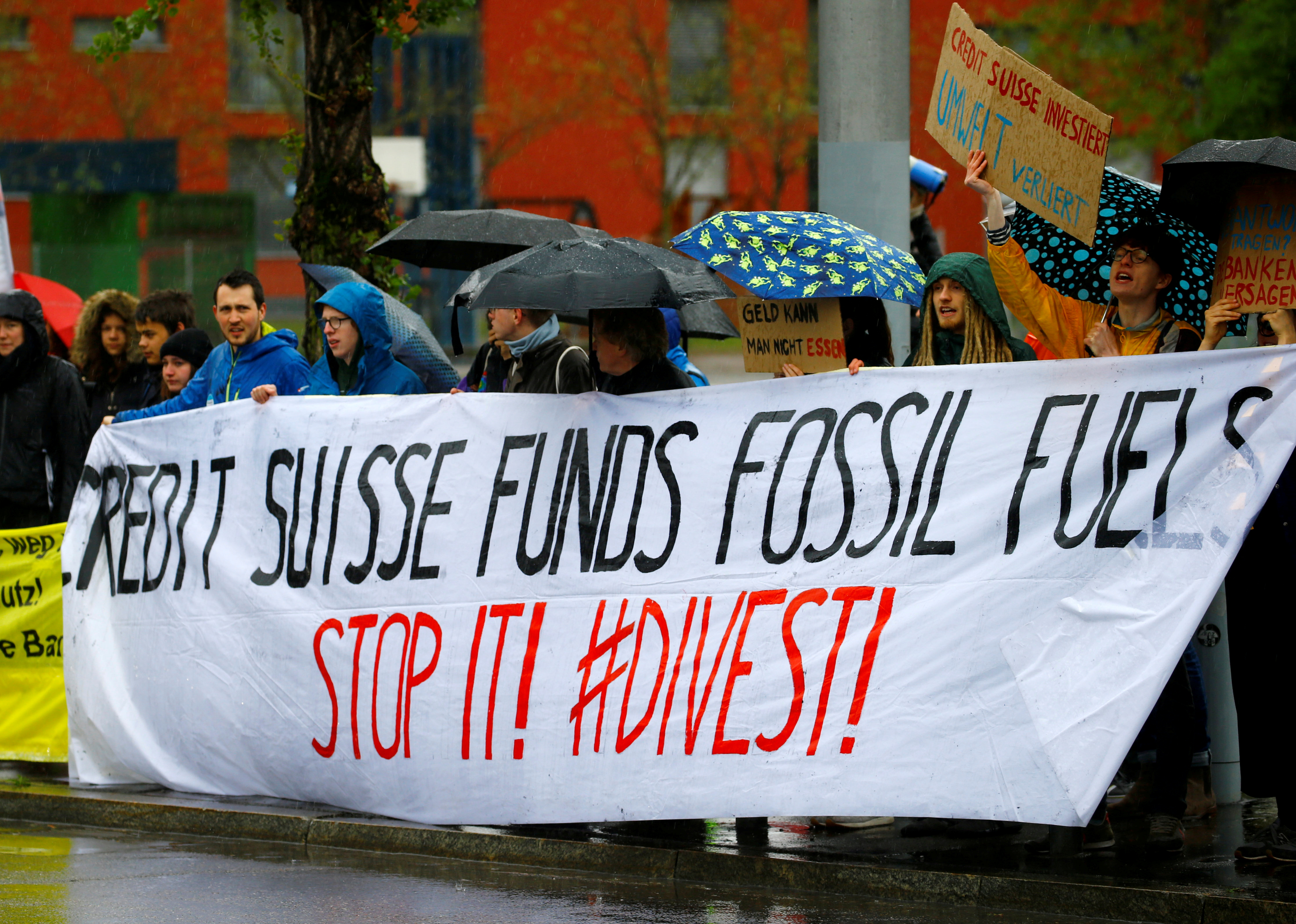 Climate protestors display a banner outside the venue where Swiss bank Credit Suisse holds the company's annual shareholder meeting in Zurich, Switzerland April 26, 2019.  REUTERS/Arnd Wiegmann/File Photo