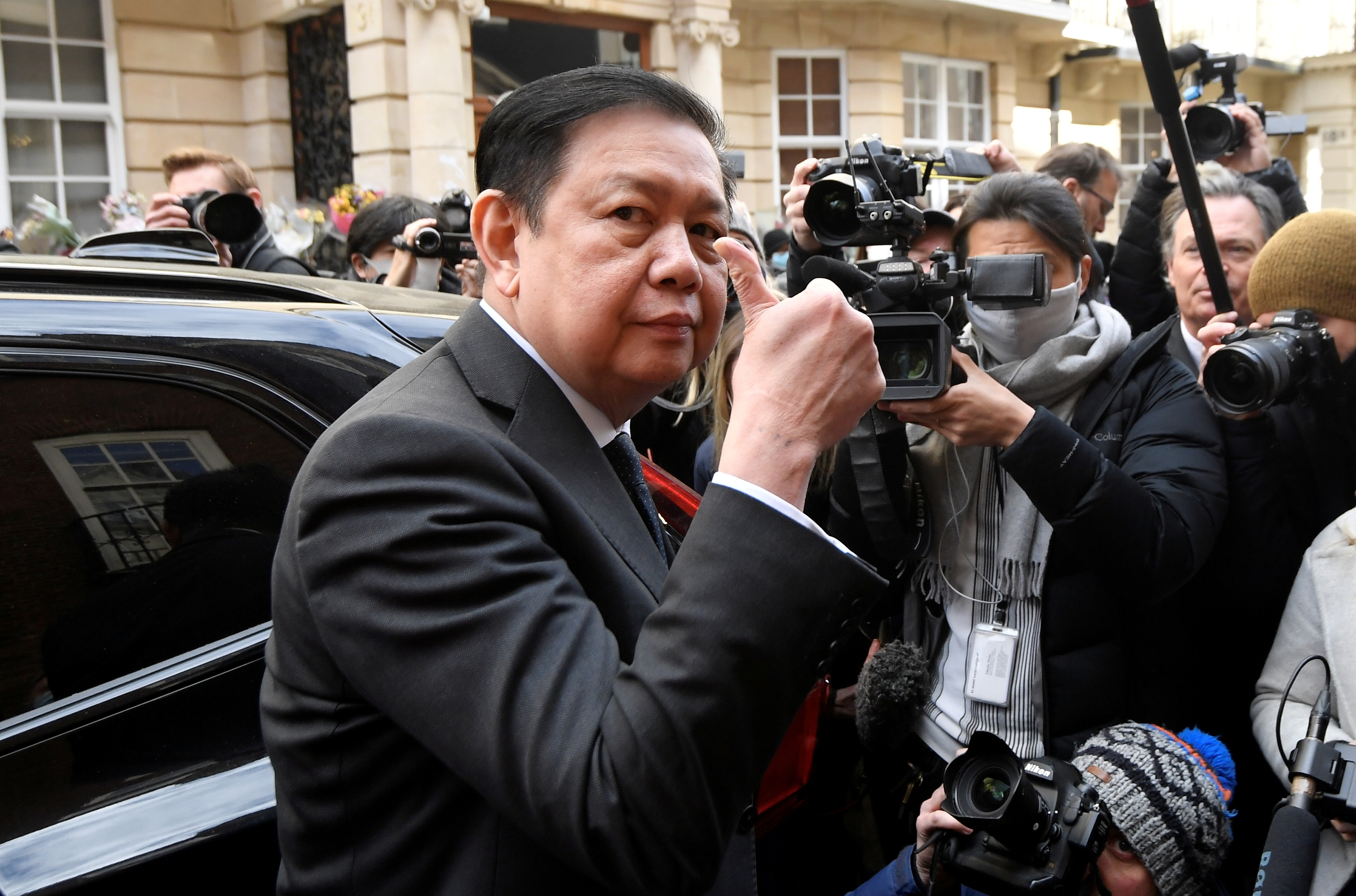 Myanmar's ambassador Kyaw Zwar Minn gestures outside the Myanmar Embassy, after he was locked out of the embassy, and sources said his deputy had shut him out of the building and taken charge on behalf of the military, in London, Britain, April 8, 2021. REUTERS/Toby Melville/File Photo