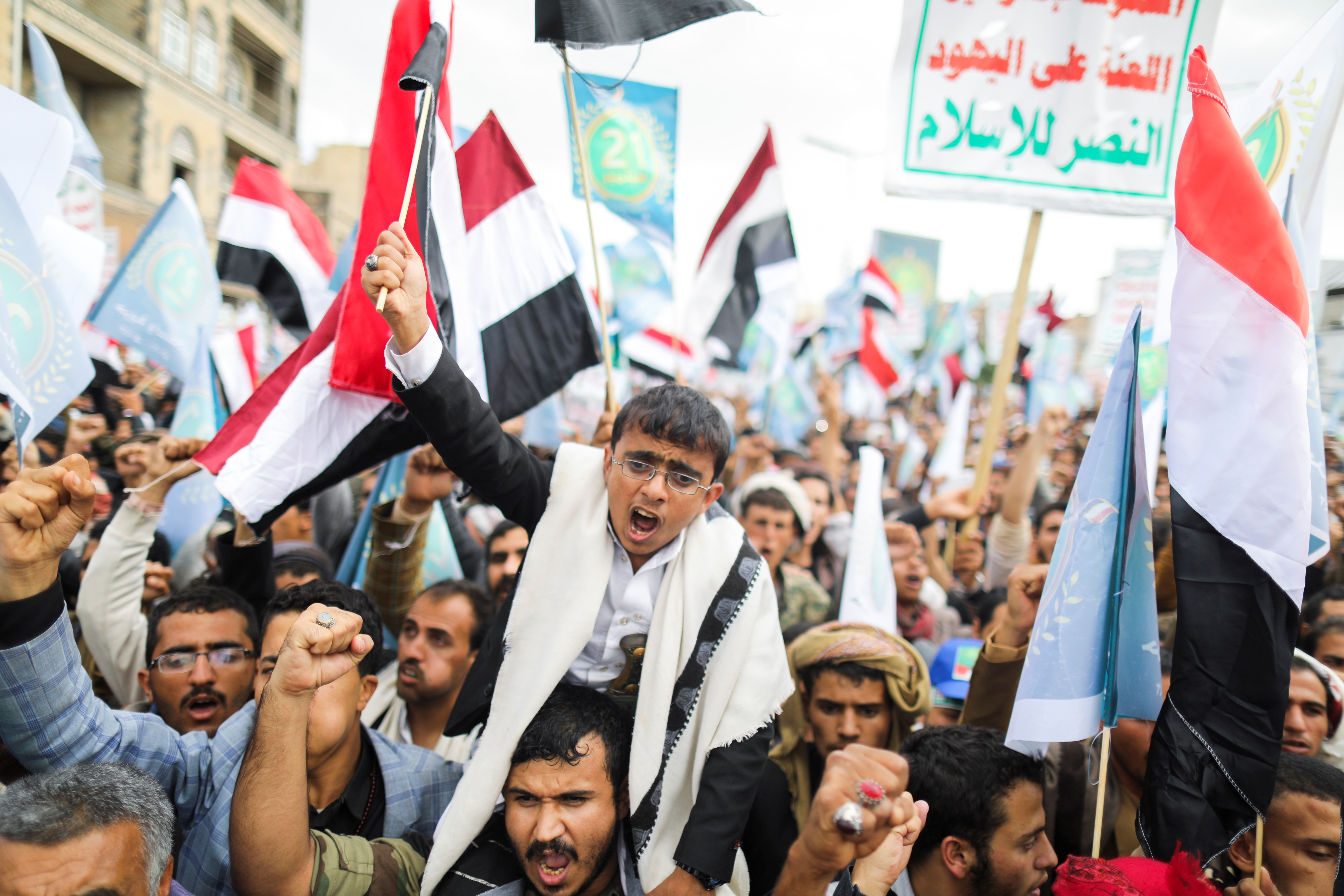 Supporters of Yemen's Houthis shout slogans during a rally to celebrate the seventh anniversary of the ousting of the government in Sanaa, Yemen September 21, 2021. REUTERS/Khaled Abdullah