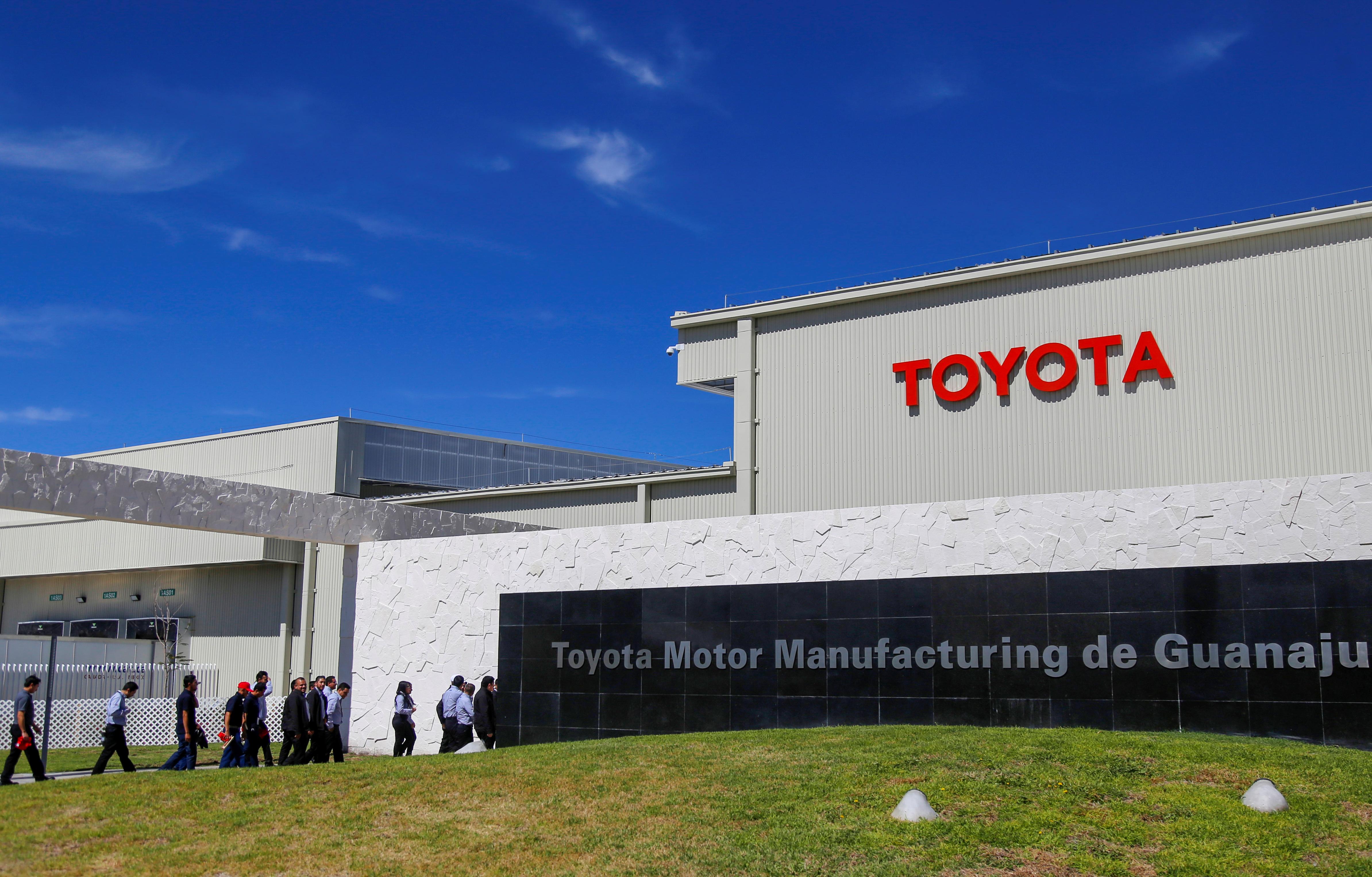 Employees walk at the Toyota Motor Corp new plant in Apaseo El Grande in Mexico's central state of Guanajuato, Mexico February 6, 2020. REUTERS/Sergio Maldonado