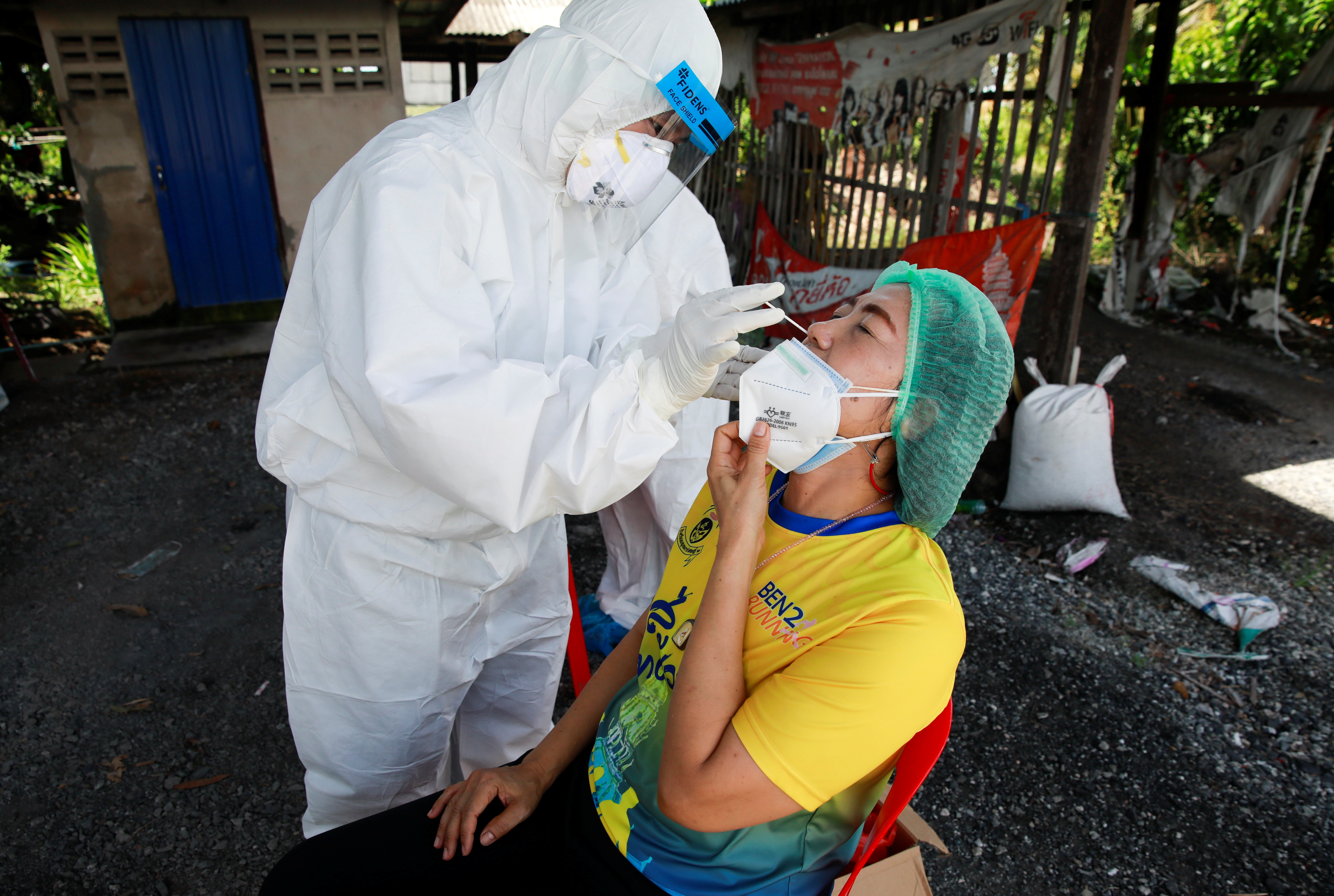 Public health officers bring coronavirus disease (COVID-19) swab testing to residents living in remote communities, amid the rise of coronavirus disease infections, in Samut Prakan, near Bangkok, Thailand, July 19, 2021. REUTERS/Soe Zeya Tun