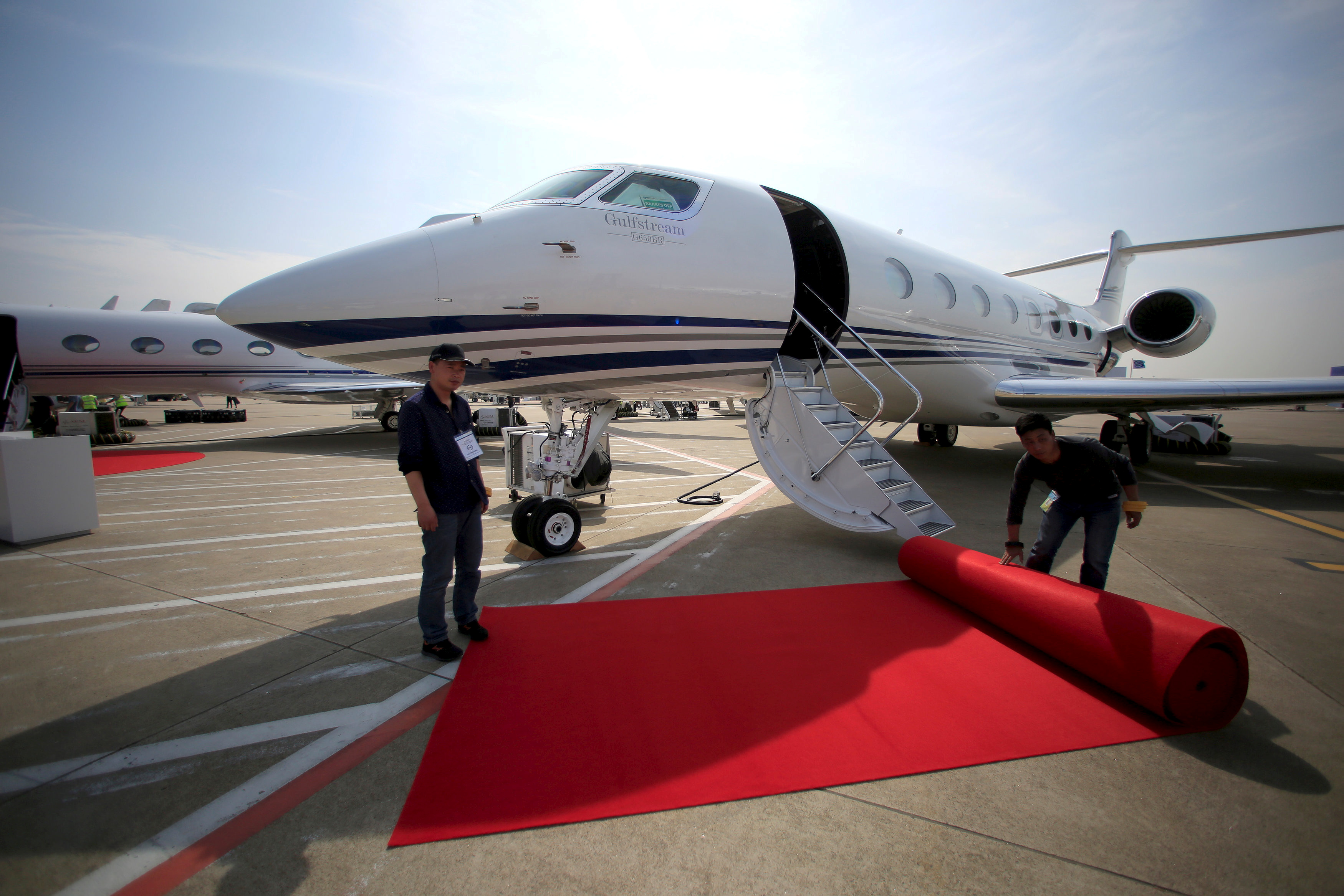 Workers prepare a red carpet in front a Gulfstream aircraft in a file photo.   REUTERS/Aly Song
