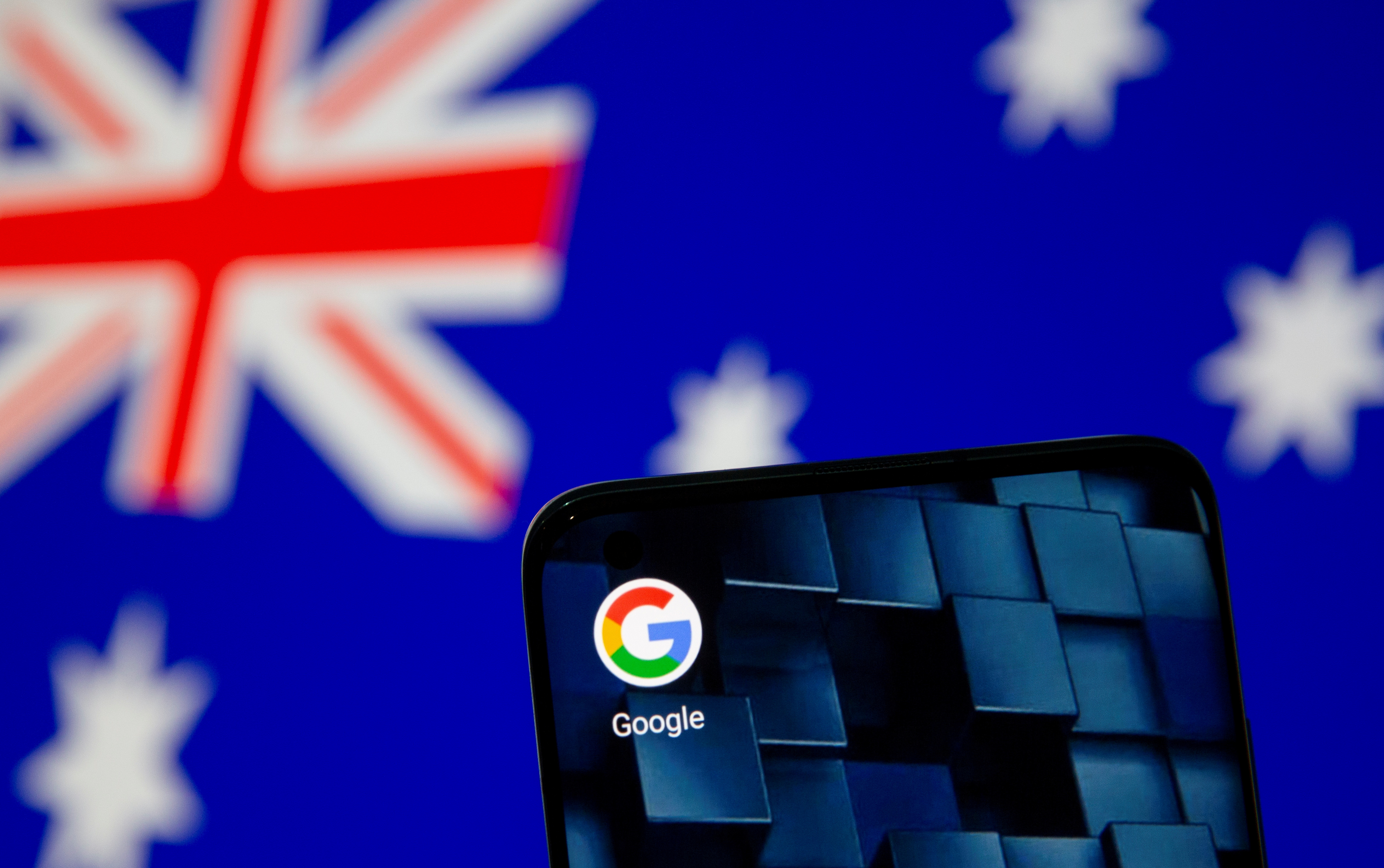 Smartphone with google app icon is seen in front of the displayed Australian flag in this illustration taken, January 22, 2021. REUTERS/Dado Ruvic/Illustration/File Photo