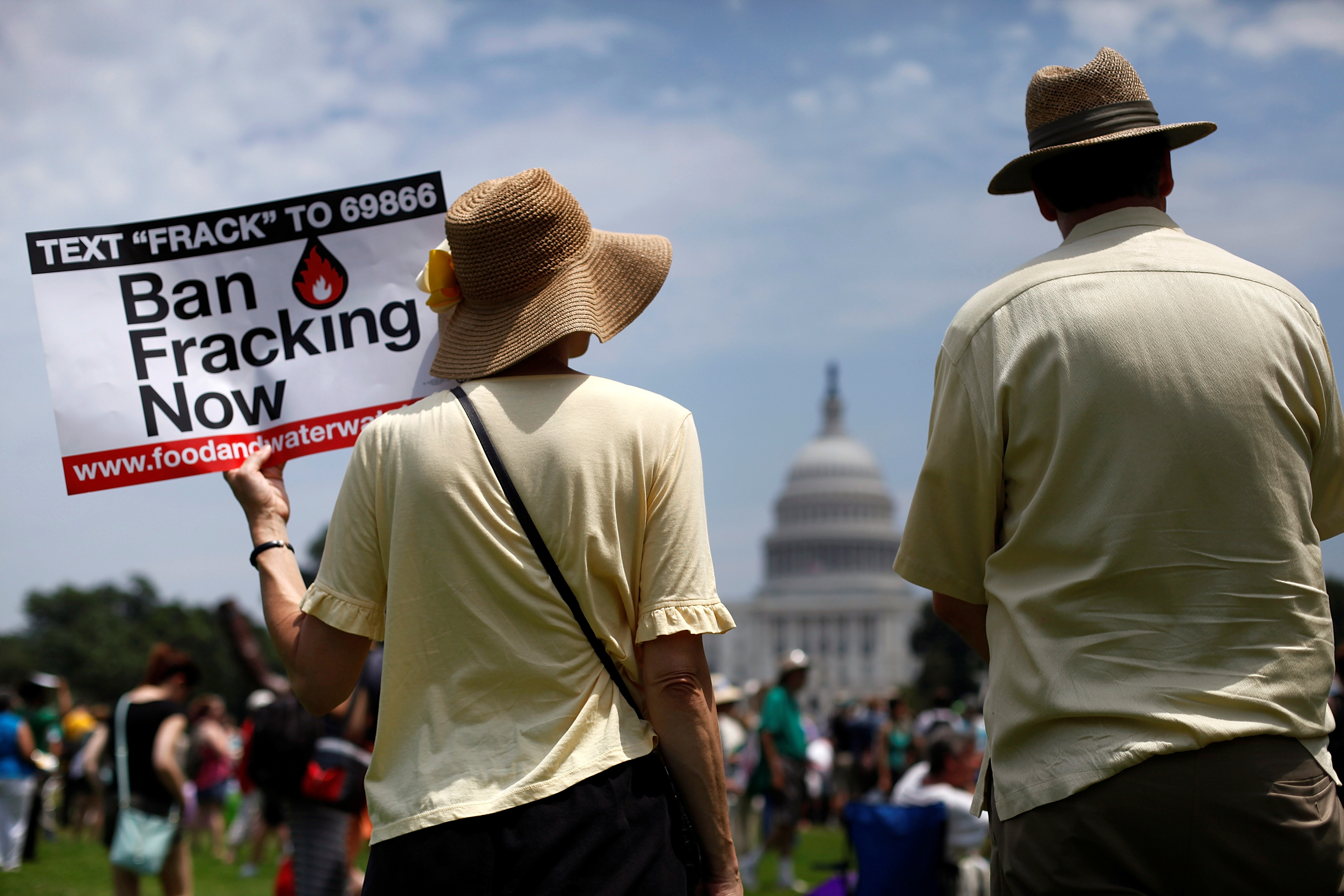 Protesters take part in a rally against U.S. fracked gas exports from the proposed Cove Point facility in Maryland, at a demonstration by several environmental organizations and activists, at the National Mall in Washington July 13, 2014. REUTERS/Jonathan Ernst/File Photo