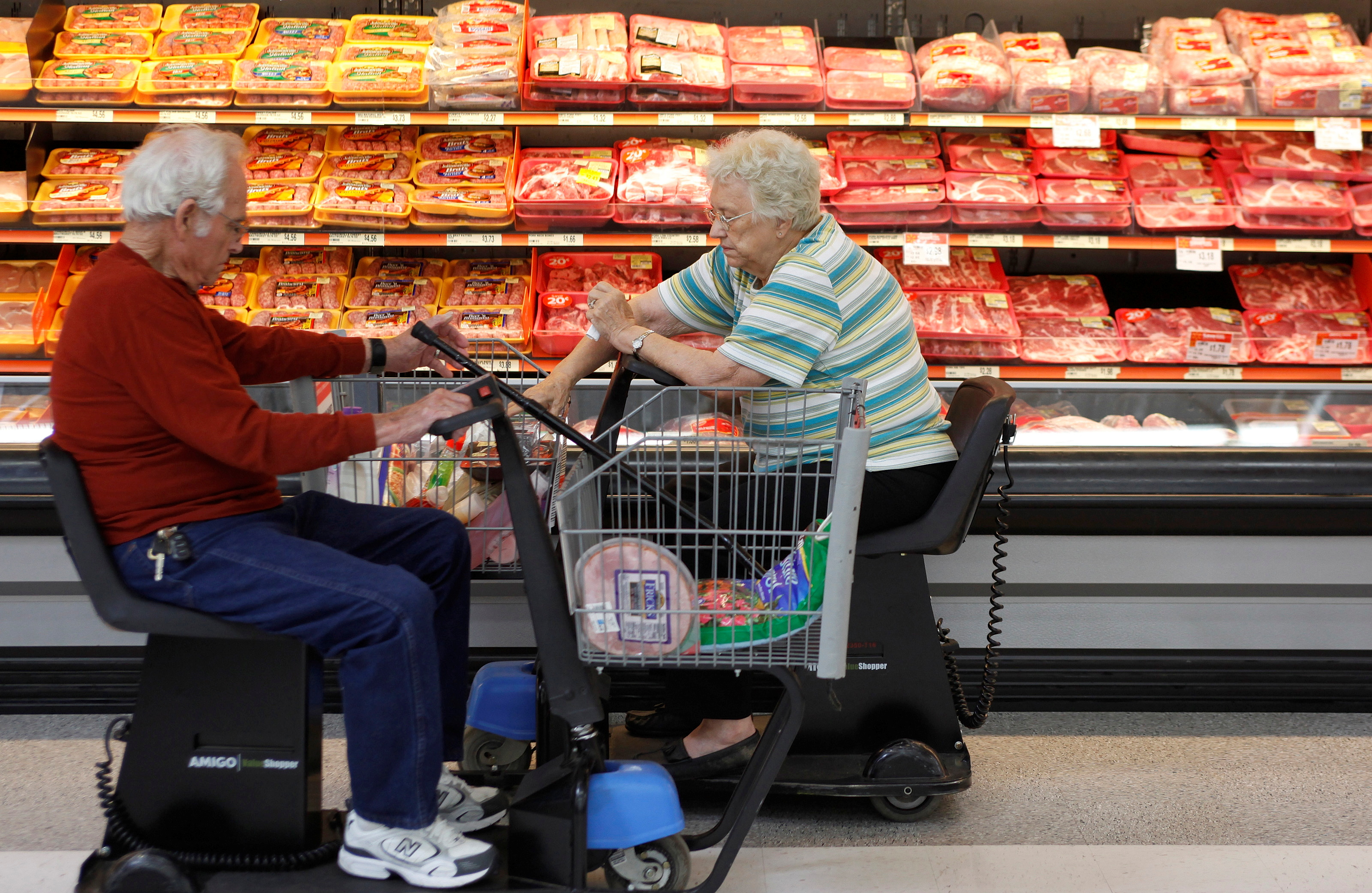 Customers shop for meat at Wal-Mart in Rogers, Arkansas, June 4, 2009. REUTERS/Jessica Rinaldi/File Photo