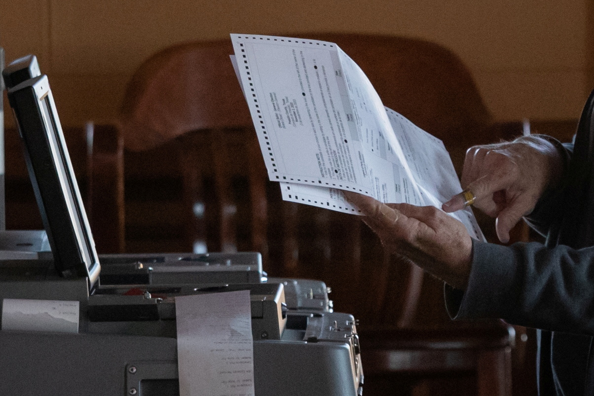 An election official points towards a mail in ballot while scanning votes for the 2020 U.S. presidential election in Marfa, Texas, U.S., November 3, 2020. REUTERS/Adrees Latif