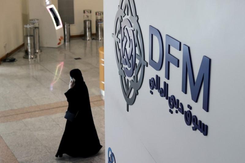A woman walks through the Dubai Financial Market after Joe Biden won the U.S. presidency, in Dubai, United Arab Emirates November 8, 2020. REUTERS/Christopher Pike/File Photo