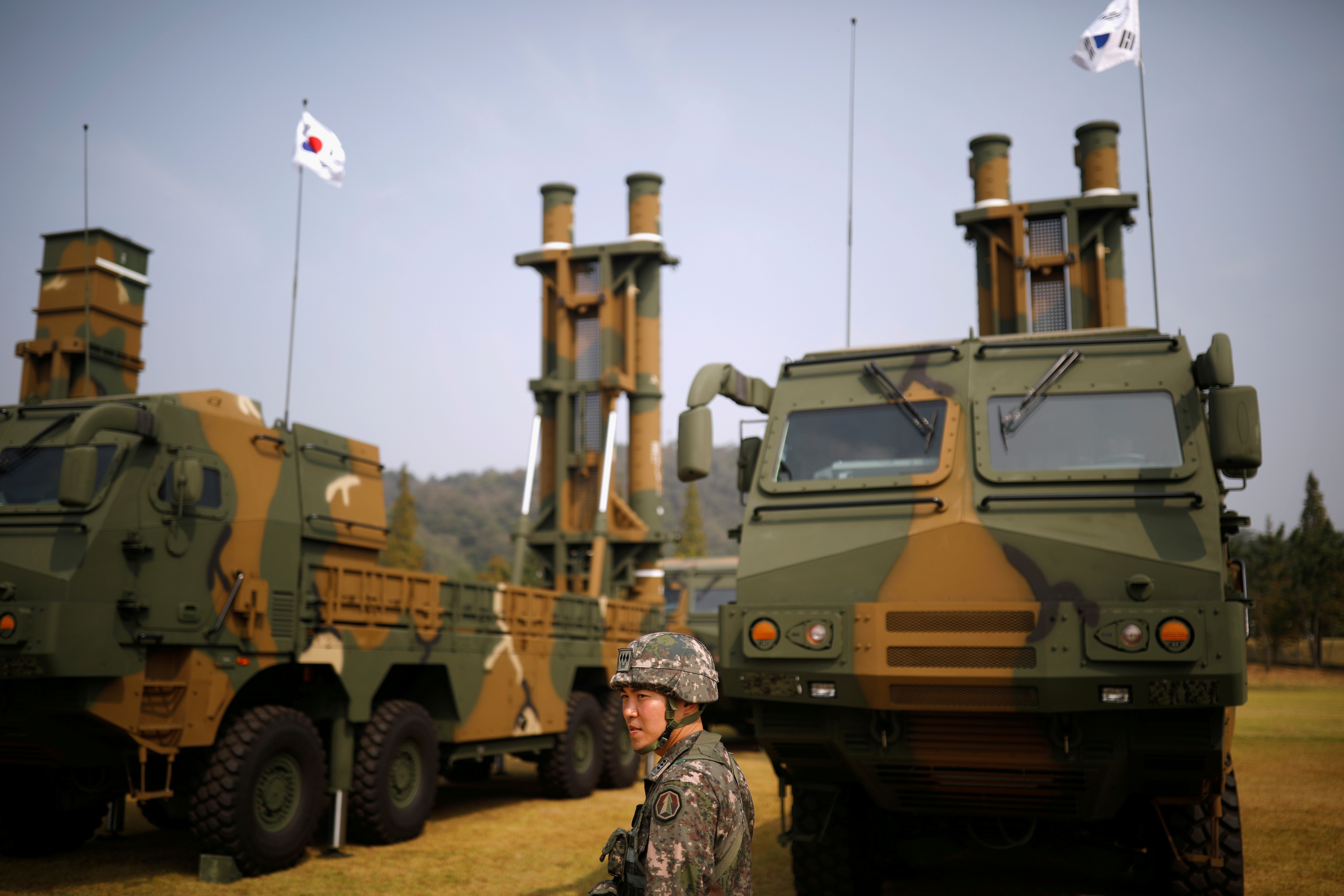 A South Korean soldier walks past Hyunmoo-2 (L) and Hyunmoo-3 ballistic missiles ahead of a celebration to mark the 69th anniversary of Korea Armed Forces Day, in Pyeongtaek, South Korea, September 25, 2017. REUTERS/Kim Hong-Ji/File Photo