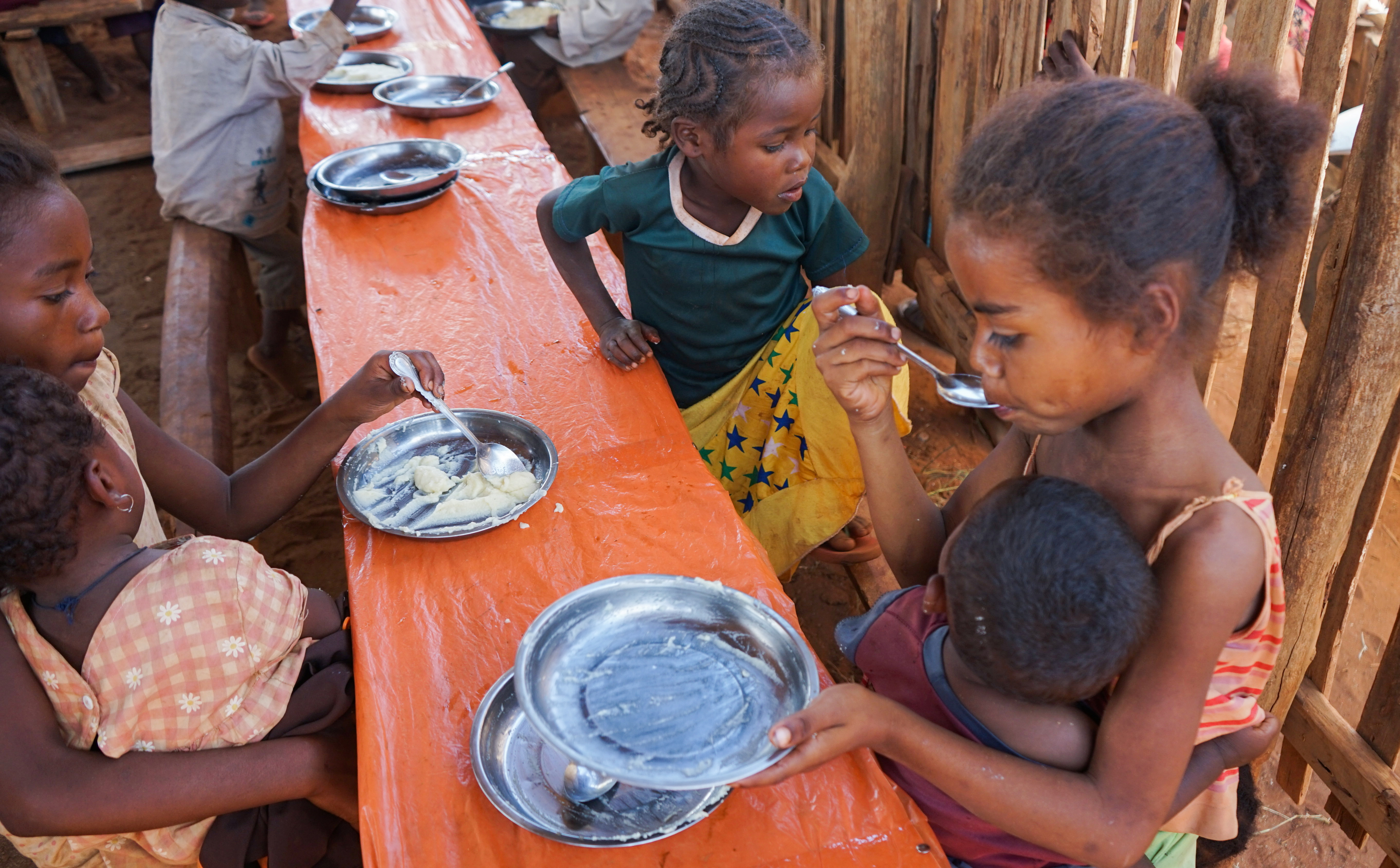 Malagasy children eat a meal at the Avotse feeding program that benefits malnourished children with hot meals in Maropia Nord village in the region of Anosy, southern Madagascar September 30, 2021. REUTERS/Joel Kouam