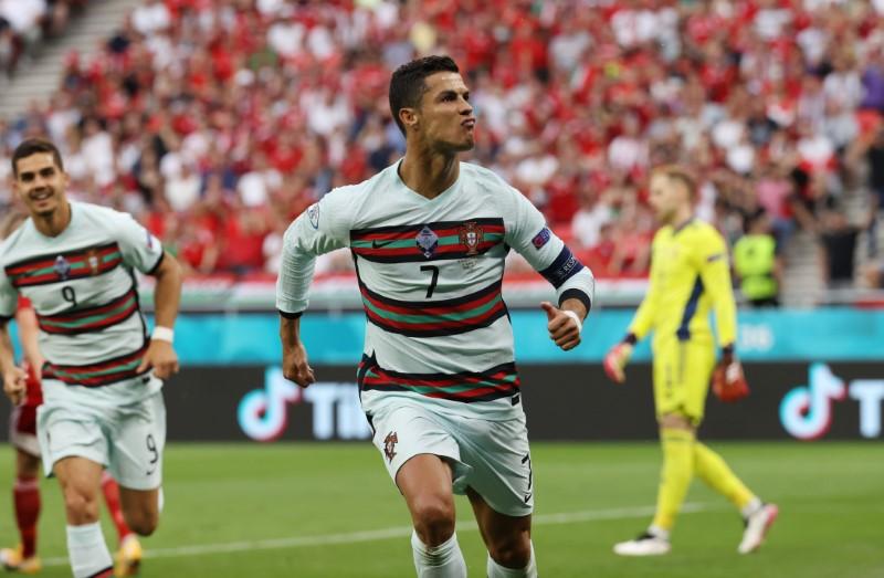 Soccer Football - Euro 2020 - Group F - Hungary v Portugal - Puskas Arena, Budapest, Hungary - June 15, 2021 Portugal's Cristiano Ronaldo celebrates scoring their second goal Pool via REUTERS/Bernadett Szabo