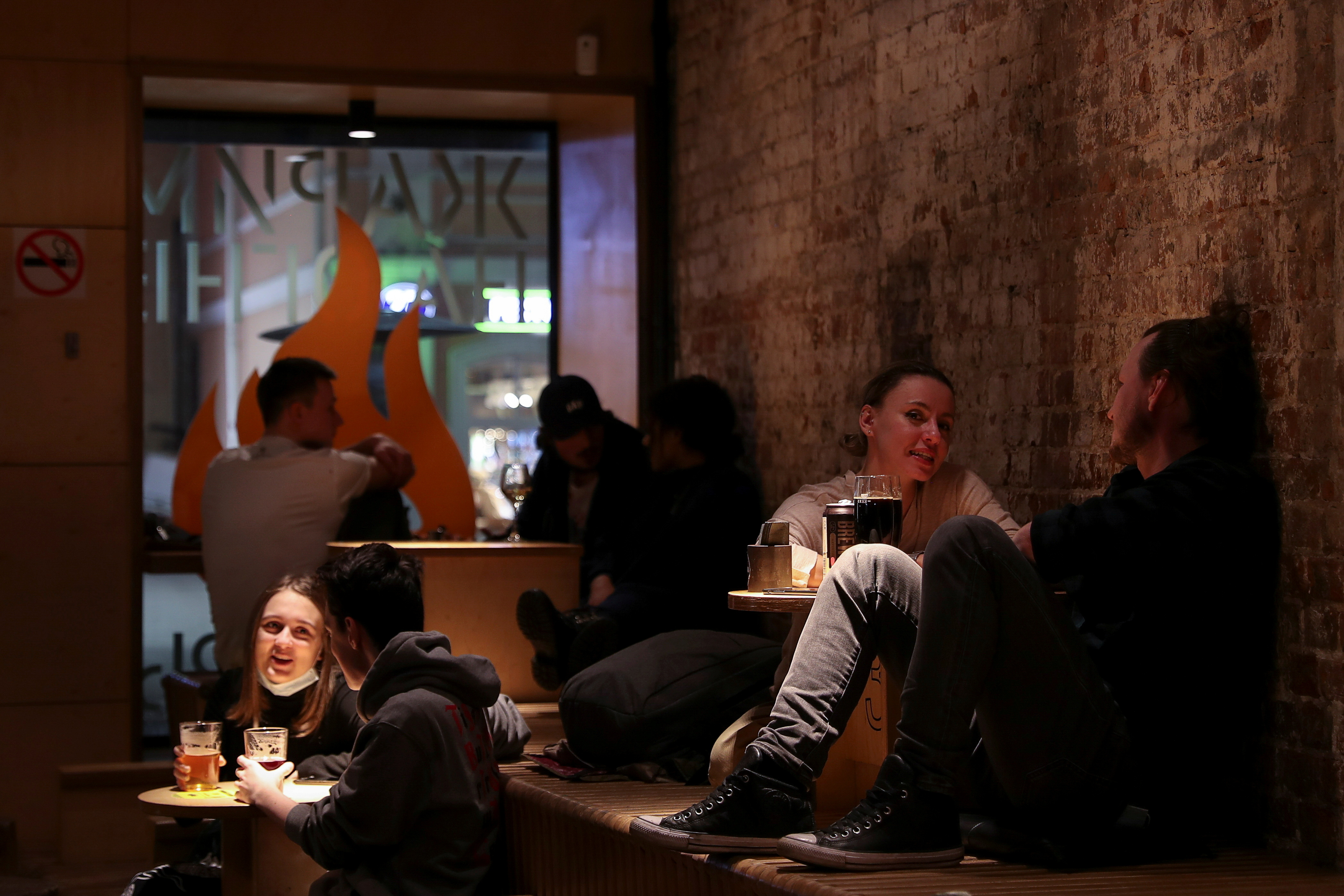 Customers sit at tables in Parka Bar in Moscow, Russia November 12, 2020. The city authorities recently ordered bars, restaurants and nightclubs to close at 11 pm amid the outbreak of the coronavirus disease (COVID-19). REUTERS/Evgenia Novozhenina