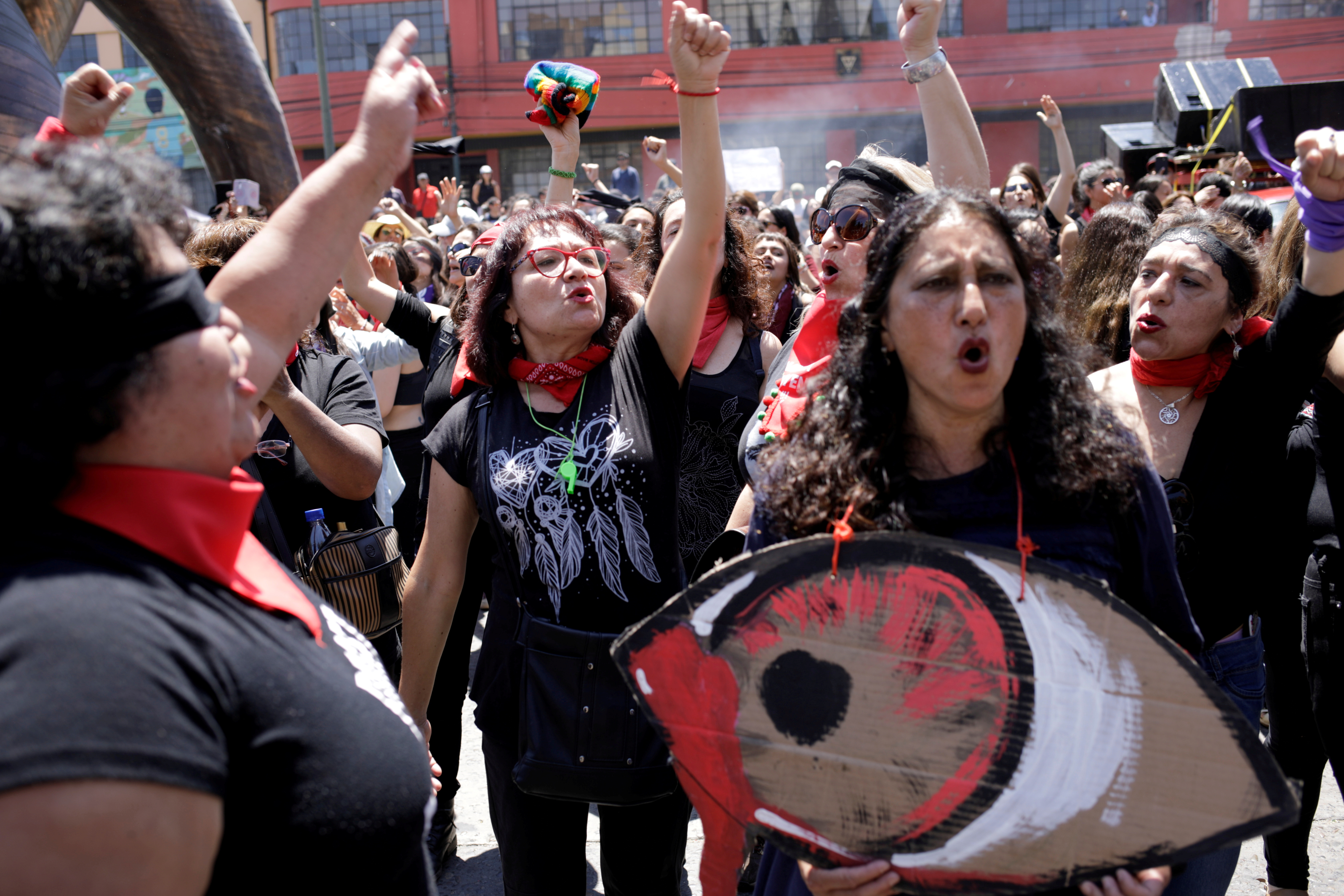 Women take part in a performance of Las Tesis feminist collective while lawmakers debate and vote on an impeachment motion against Chile's President Sebastian Pinera, in Valparaiso, Chile December 12, 2019. REUTERS/Andres Martinez Casares/File Photo