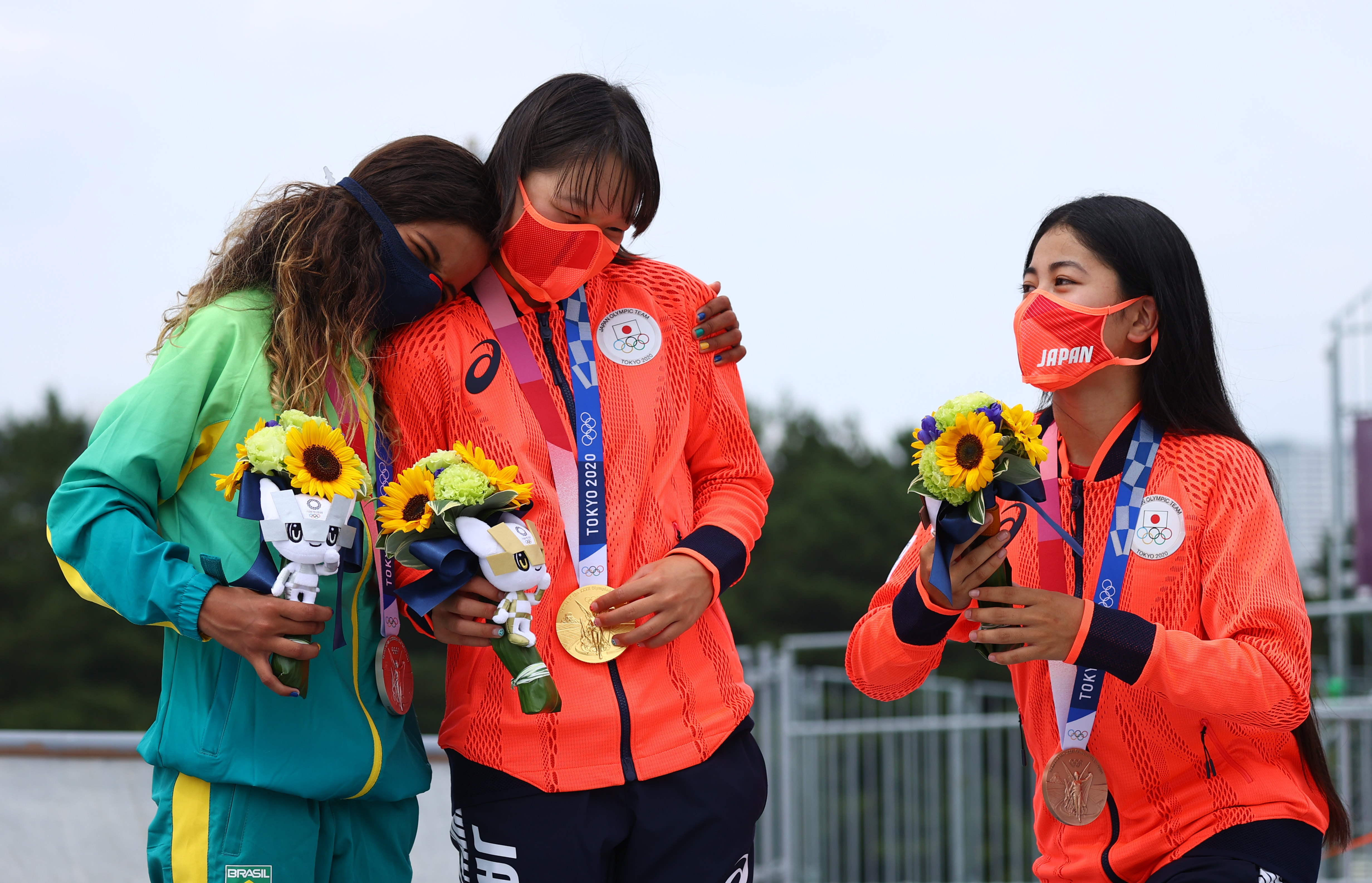 Tokyo 2020 Olympics - Skateboarding - Women's Street - Medal Ceremony - Ariake Urban Sports Park - Tokyo, Japan - July 26, 2021. Rayssa Leal of Brazil, Momiji Nishiya of Japan and Funa Nakayama of Japan pose with their medals during medal ceremony. REUTERS/Lucy Nicholson
