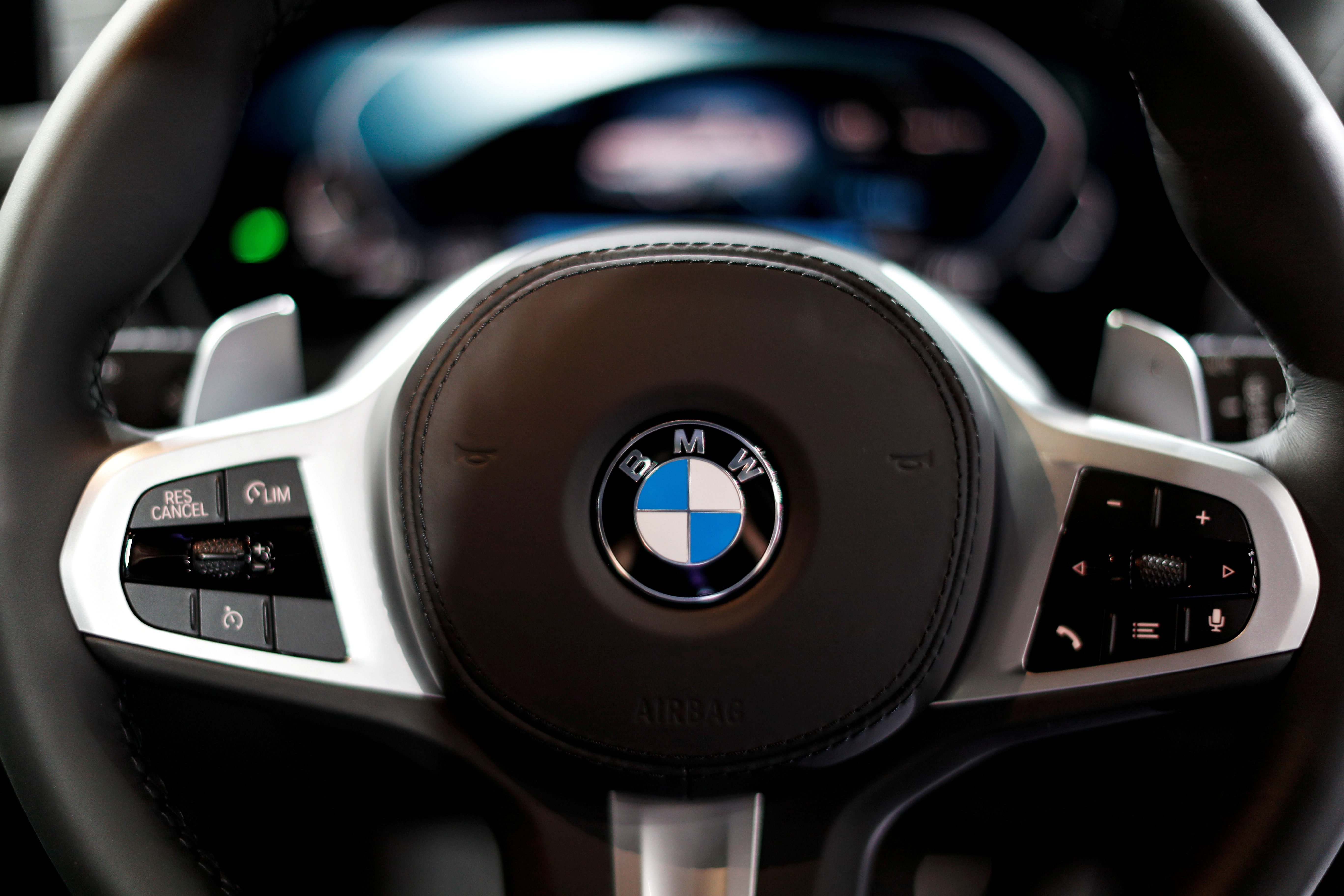 The BMW logo is seen on a steering wheel during the media day of the 41st Bangkok International Motor Show after the Thai government eased measures to prevent the spread of the coronavirus disease (COVID-19) in Bangkok, Thailand July 14, 2020. REUTERS/Jorge Silva/File Photo
