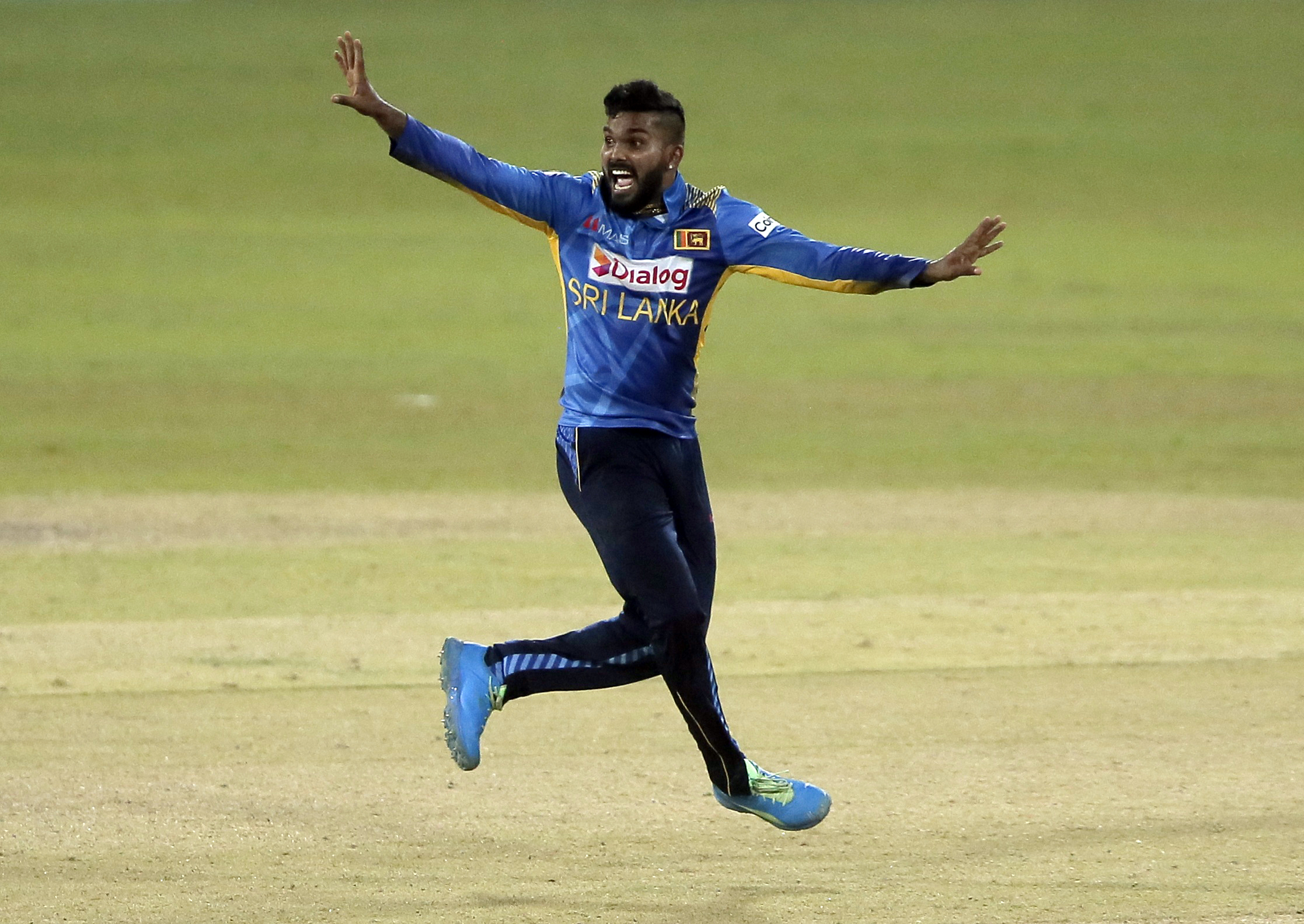 Cricket - Second One Day International - Sri Lanka v India - R. Premadasa International Cricket Stadium, Colombo, Sri Lanka - July 20, 2021 Sri Lanka's Wanindu Hasaranga appeals for a successful LBW wicket of India's Shikhar Dhawan REUTERS/Dinuka Liyanawatte