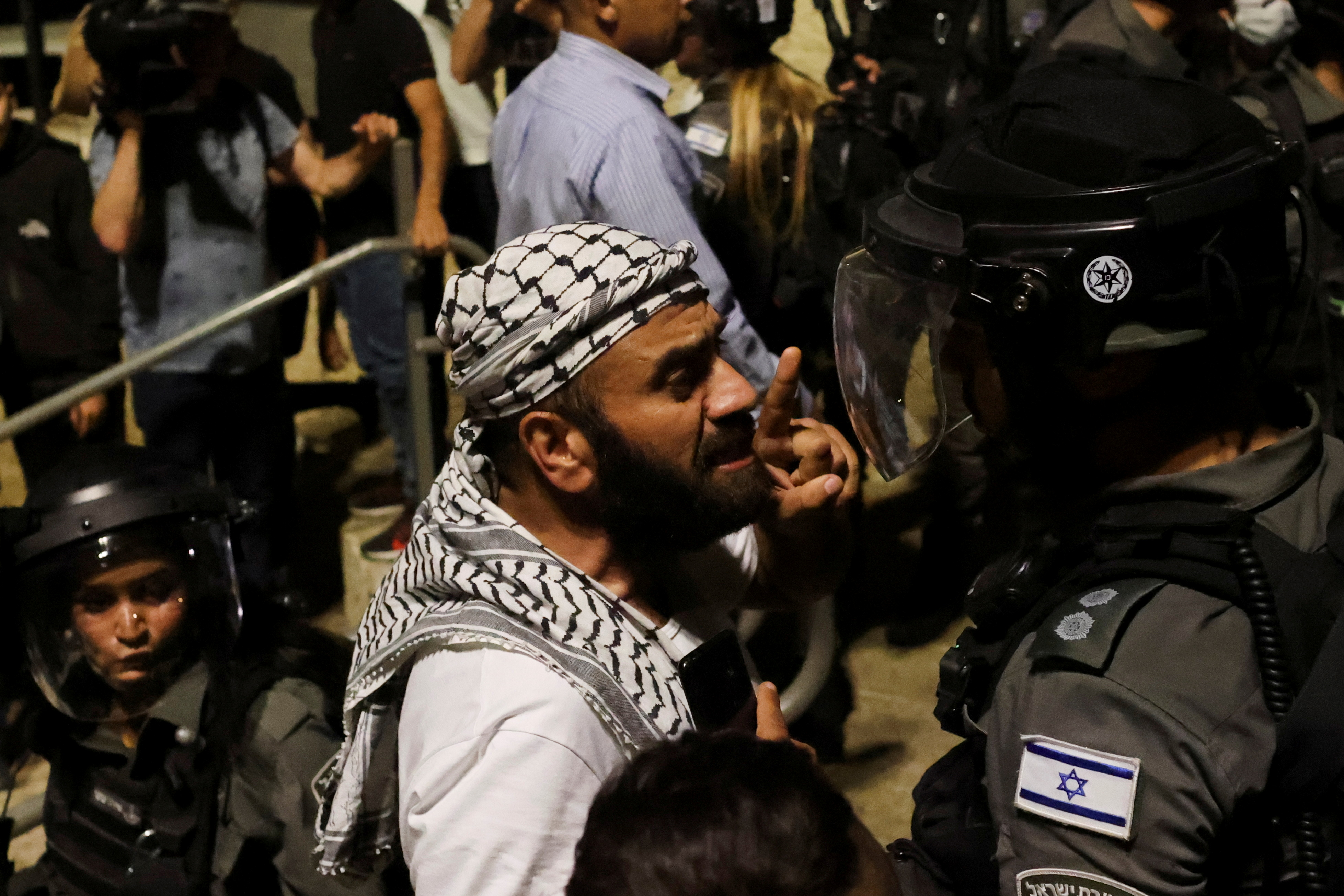 A Palestinian man gestures as he argues with an Israeli border policeman by the entrance to Jerusalem's Old City May 9, 2021.  REUTERS/Ronen Zvulun