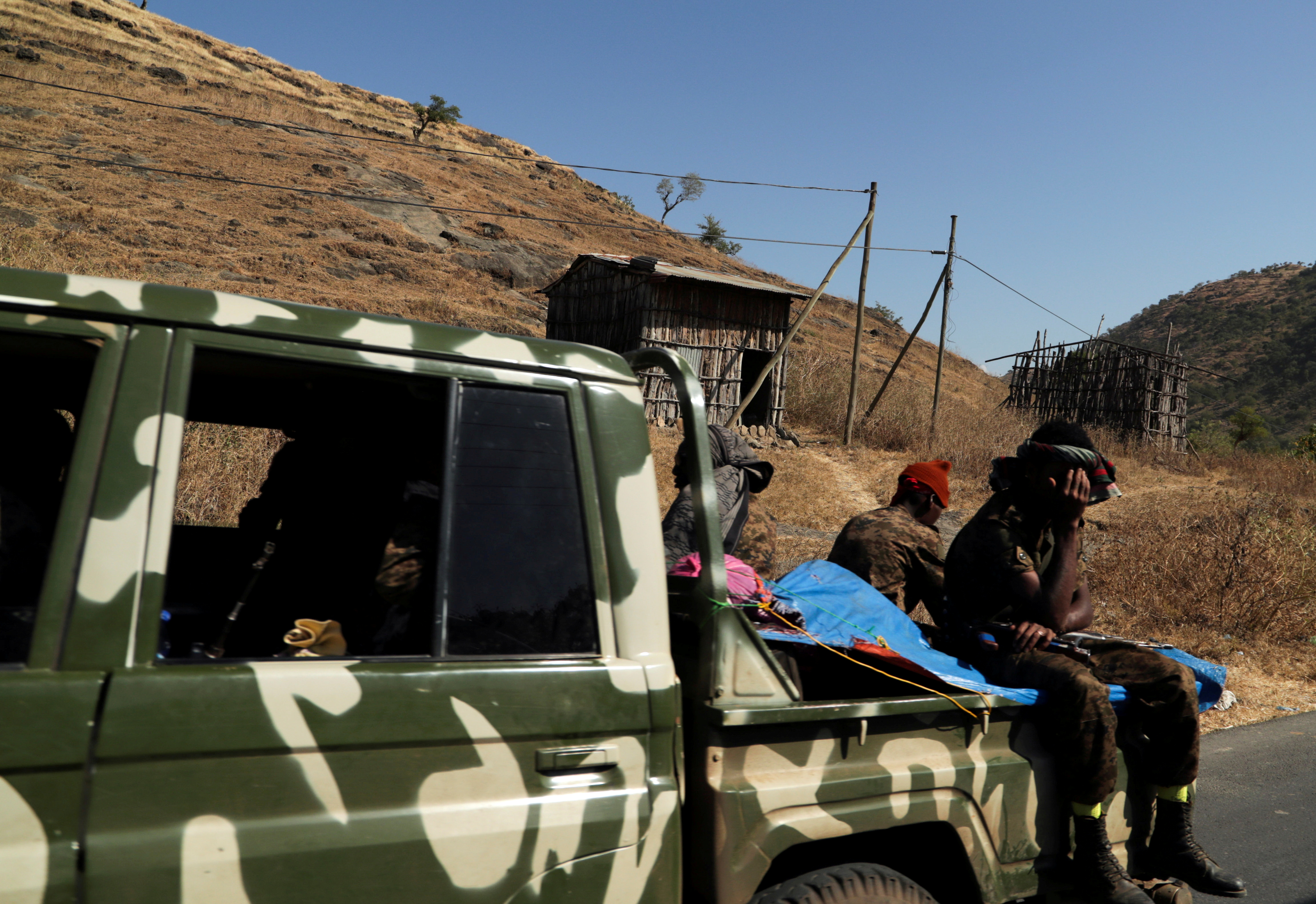 Members of the Ethiopian National Defense Force (ENDF) ride on their pickup truck as they head to mission in Sanja, Amhara region, near a border with Tigray, Ethiopia November 9, 2020. REUTERS/Tiksa Negeri/File Photo