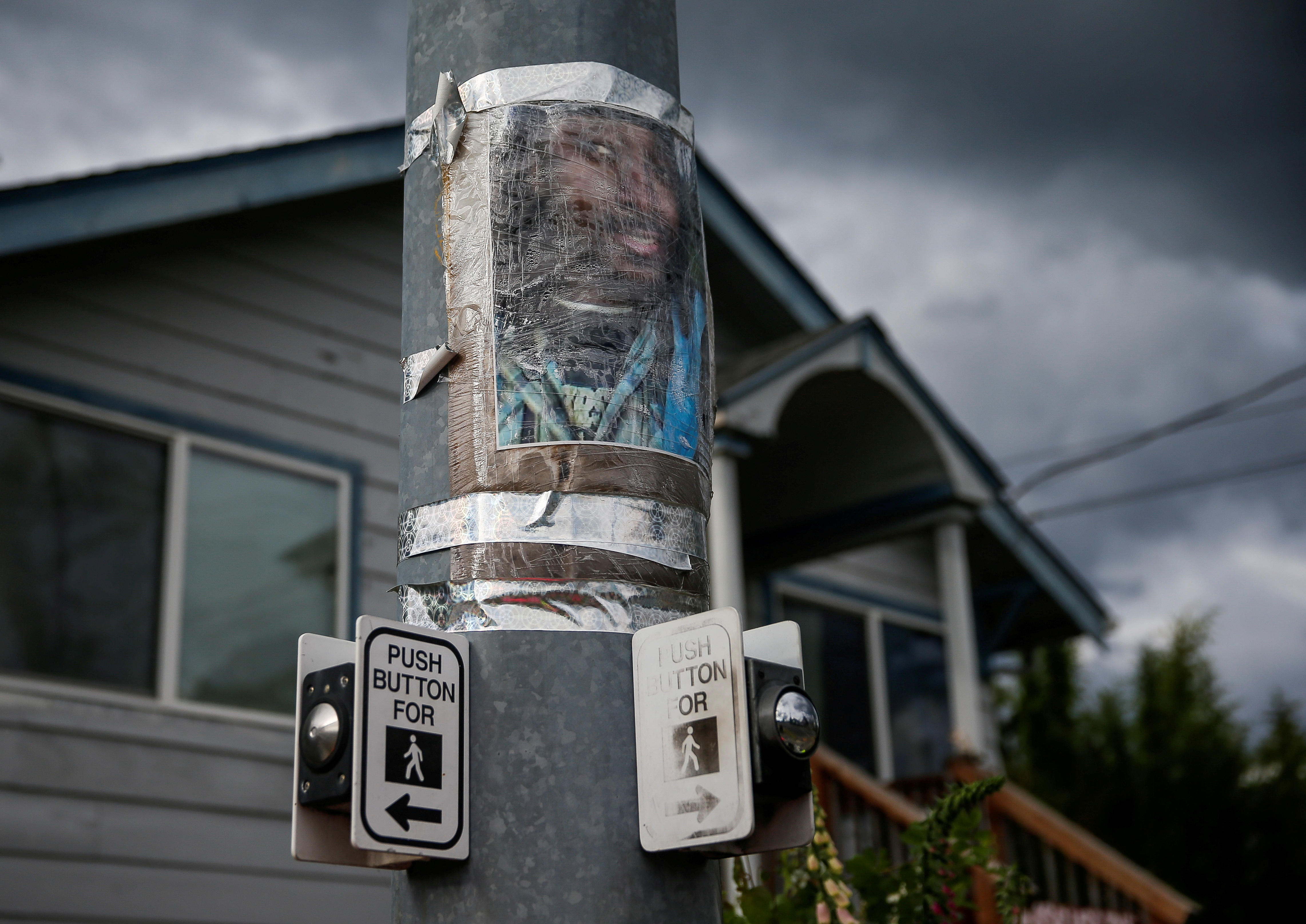 A photo of Manuel Ellis, who died in Tacoma police custody in March, is taped to a pole at a vigil site in Tacoma, Washington, U.S. June 5, 2020. REUTERS/Lindsey Wasson/File Photo