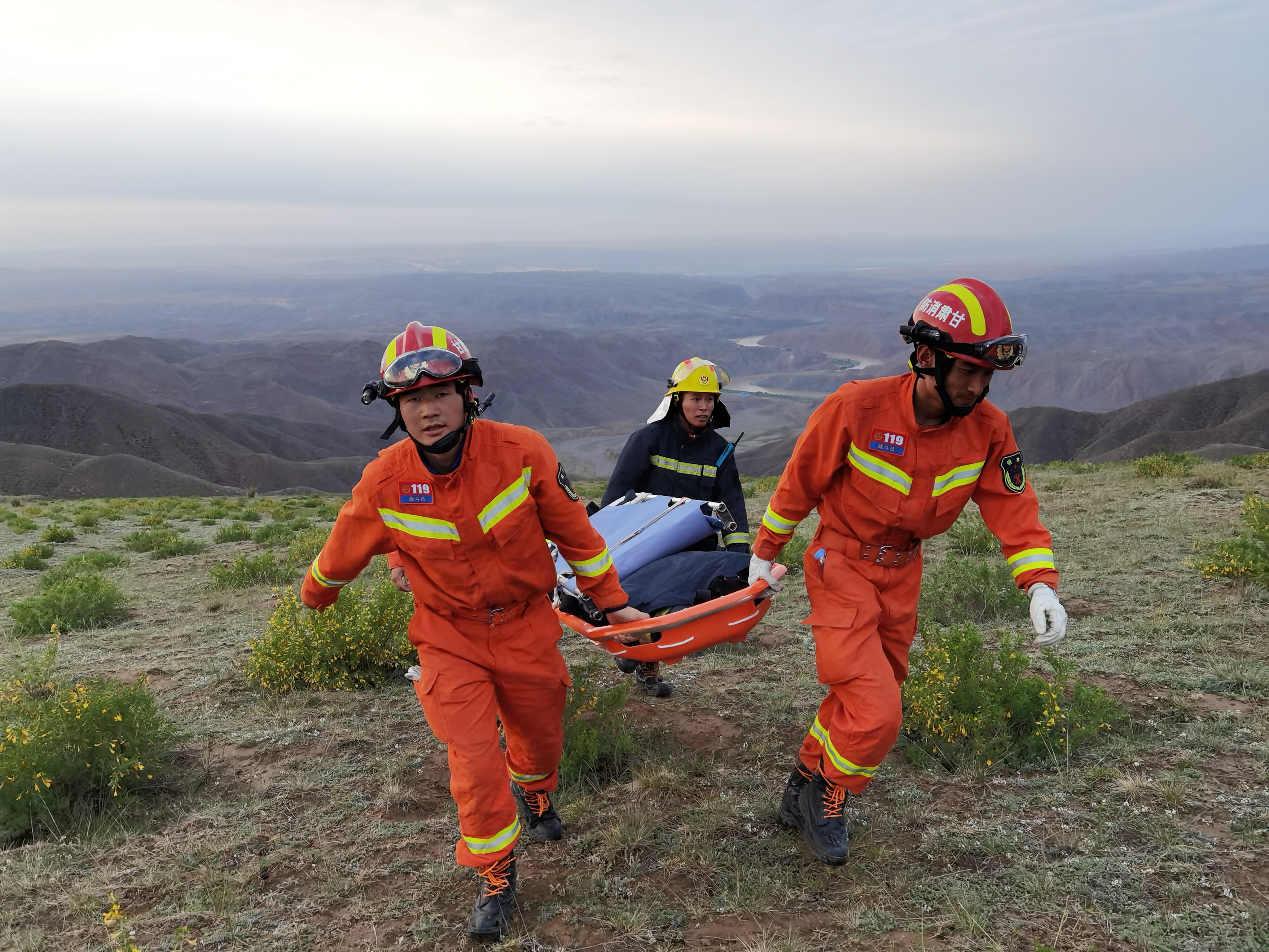 Rescue workers carry a stretcher as they work at the site where extreme cold weather killed participants of an 100-km ultramarathon race in Baiyin, Gansu province, China May 22, 2021. Picture taken May 22, 2021. cnsphoto via REUTERS