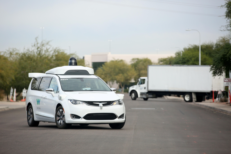 A Waymo Chrysler Pacifica Hybrid self-driving vehicle returns to a depot in Chandler, Arizona, November 29, 2018. REUTERS/Caitlin O'Hara/File Photo