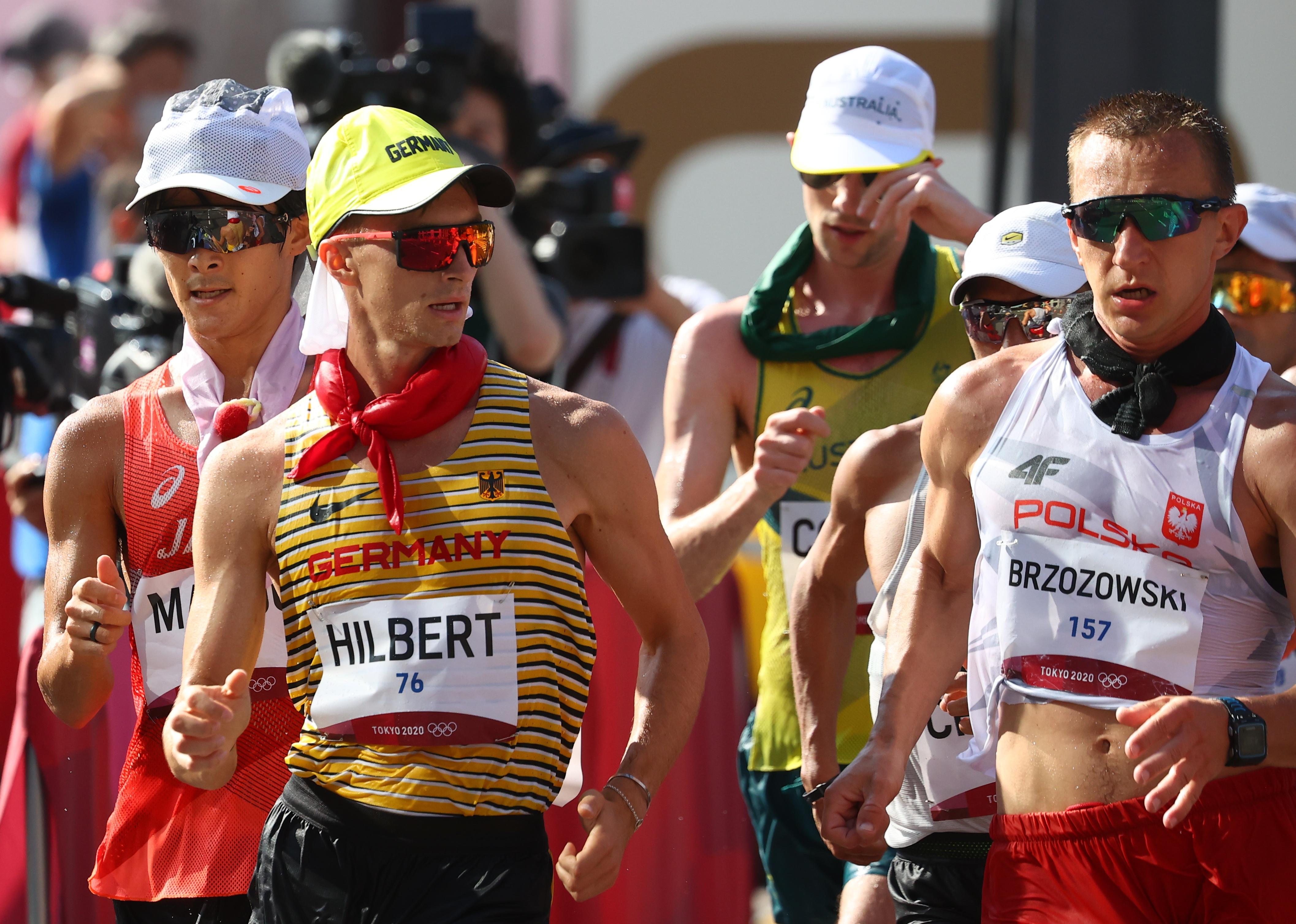 Tokyo 2020 Olympics - Athletics - Men's 50km Walk - Sapporo Odori Park, Sapporo, Japan - August 6, 2021.  Jonathan Hilbert of Germany and Artur Brzozowski of Poland in action REUTERS/Kim Hong-Ji - SP1EH851RNR16