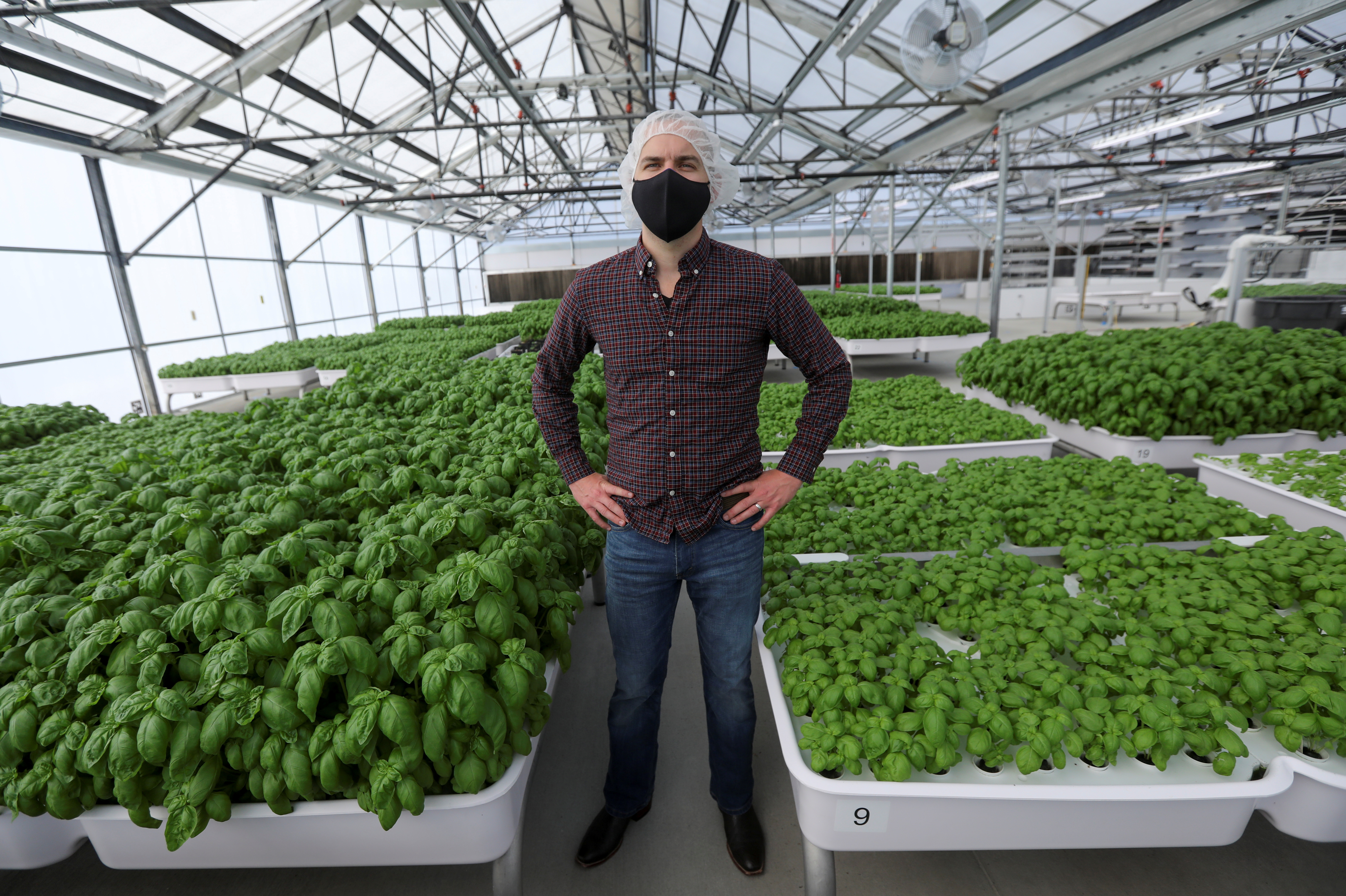 Iron Ox CEO Brandon Alexander poses for a portrait in the company's greenhouse in Gilroy, California, U.S. on September 15, 2021. Picture taken September 15, 2021. REUTERS/Nathan Frandino