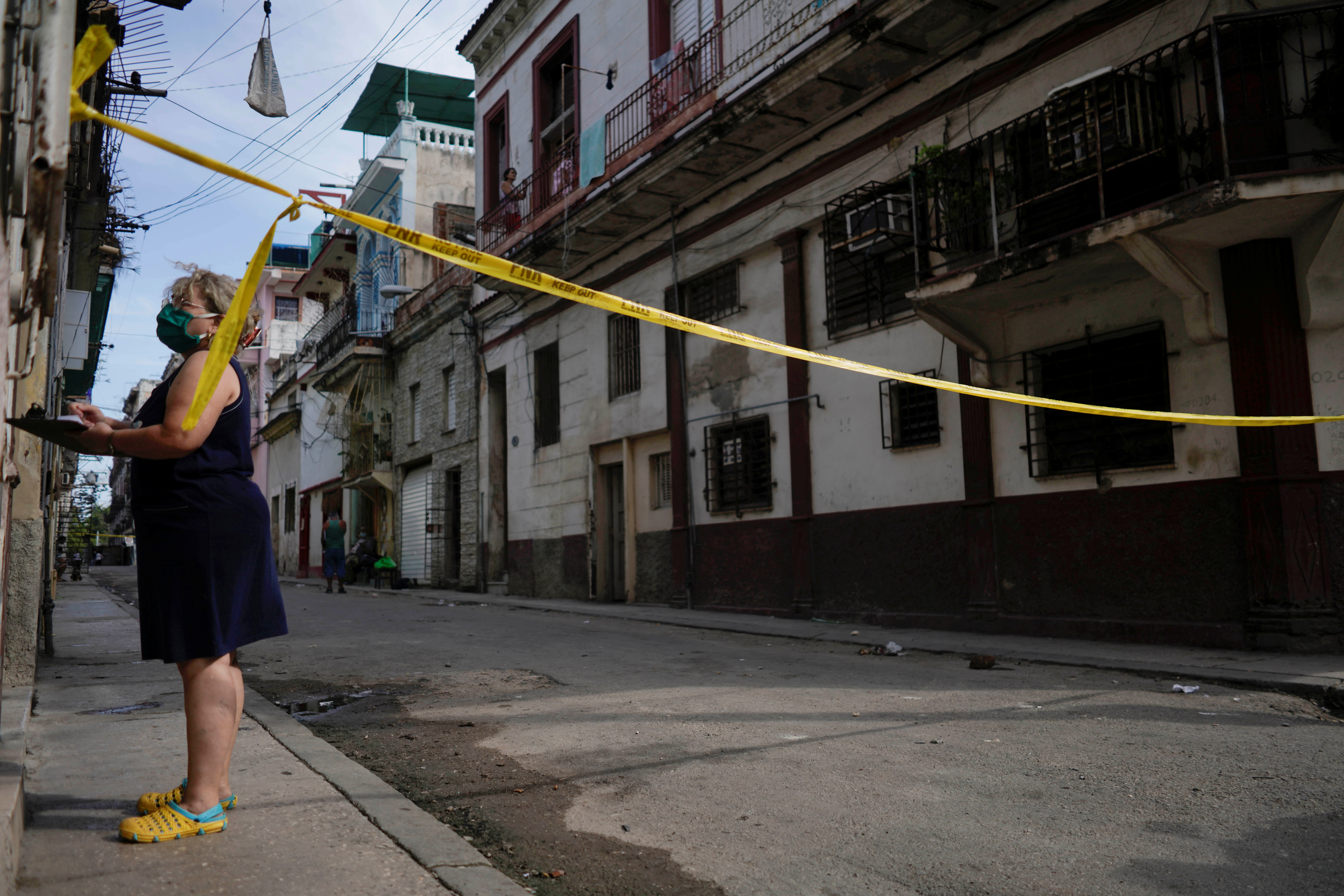 A health worker asks questions in a quarantine area amid concerns about the spread of the coronavirus disease (COVID-19) in Havana, Cuba, April 8, 2021. Picture taken April 8, 2021. REUTERS/Alexandre Meneghini