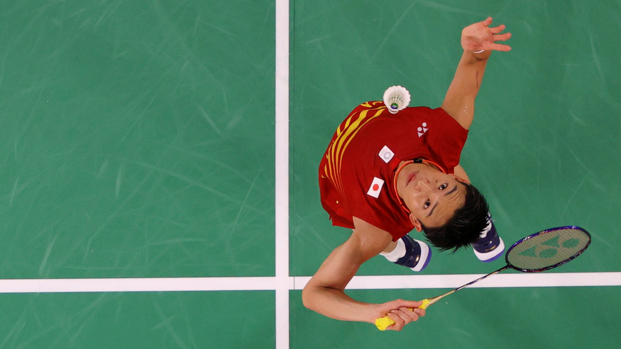 Tokyo 2020 Olympics - Badminton - Men's Singles - Group Stage - MFS - Musashino Forest Sport Plaza, Tokyo, Japan – July 28, 2021. Kento Momota of Japan in action during the match against Heo Kwang-Hee of South Korea. Pool via REUTERS/Lintao Zhang