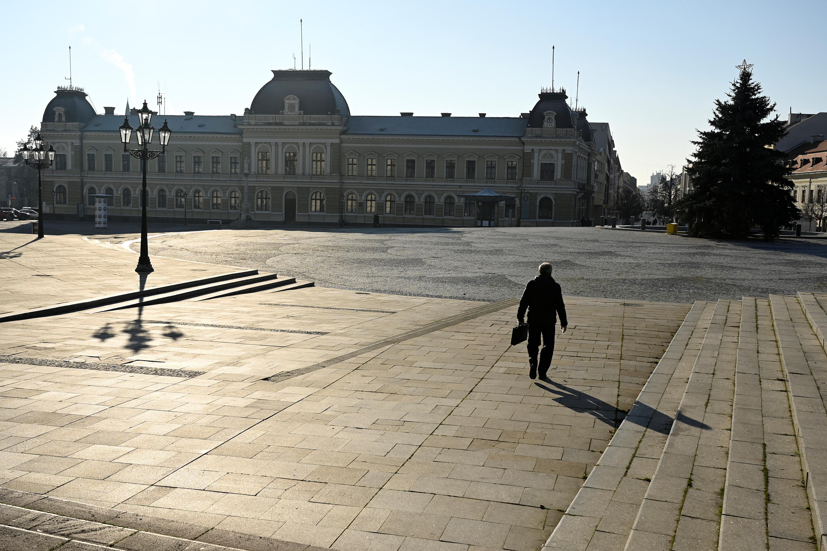 A man walks through the empty downtown, amid the spread of the coronavirus disease (COVID-19),  in Nitra, Slovakia January 11, 2021. REUTERS/Radovan Stoklasa