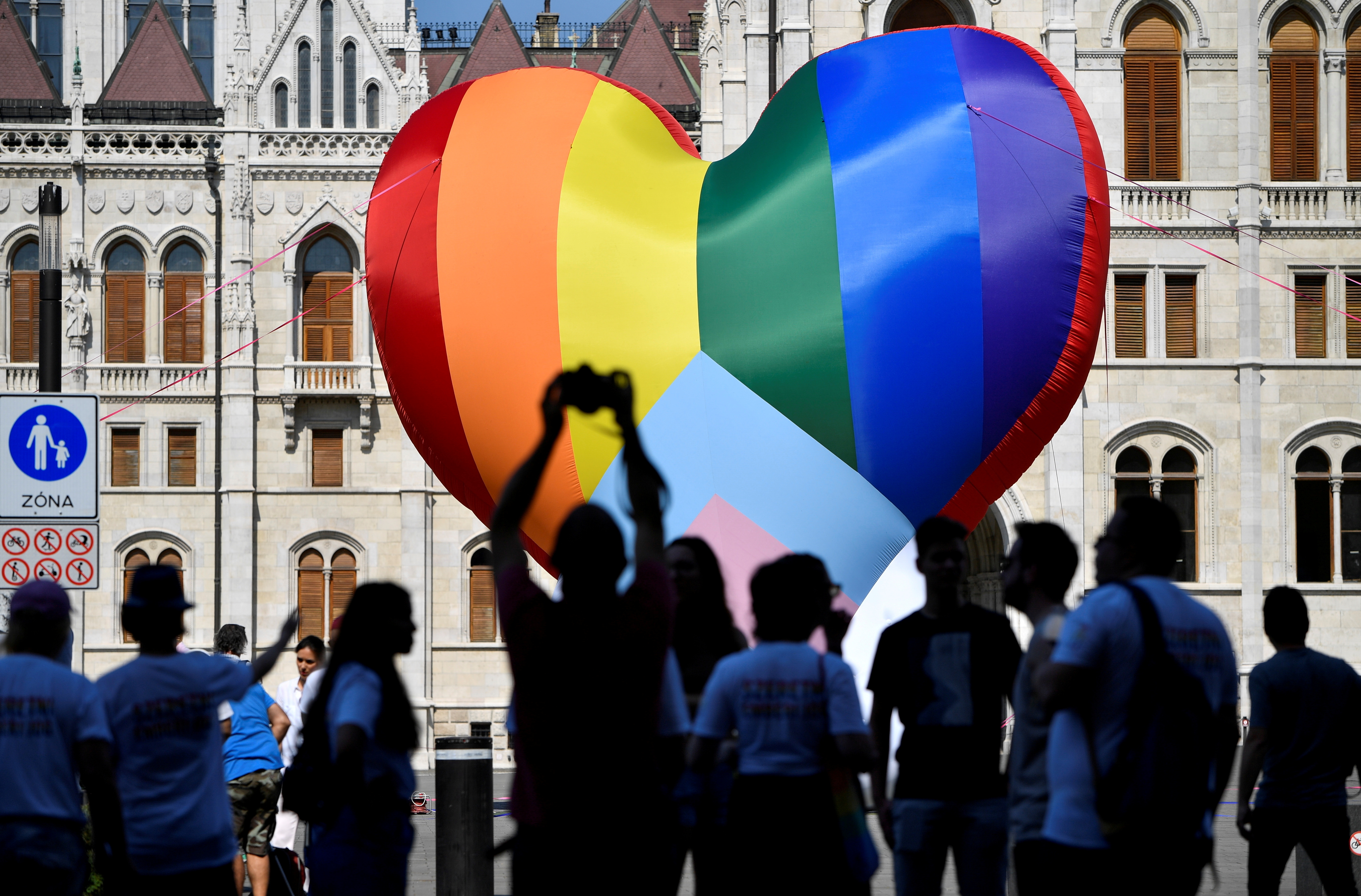 People gather in front of a huge rainbow balloon put up by members of Amnesty International and Hatter, an NGO promoting LGBT rights, at Hungary's parliament in Budapest, Hungary, July 8, 2021. REUTERS/Marton Monus