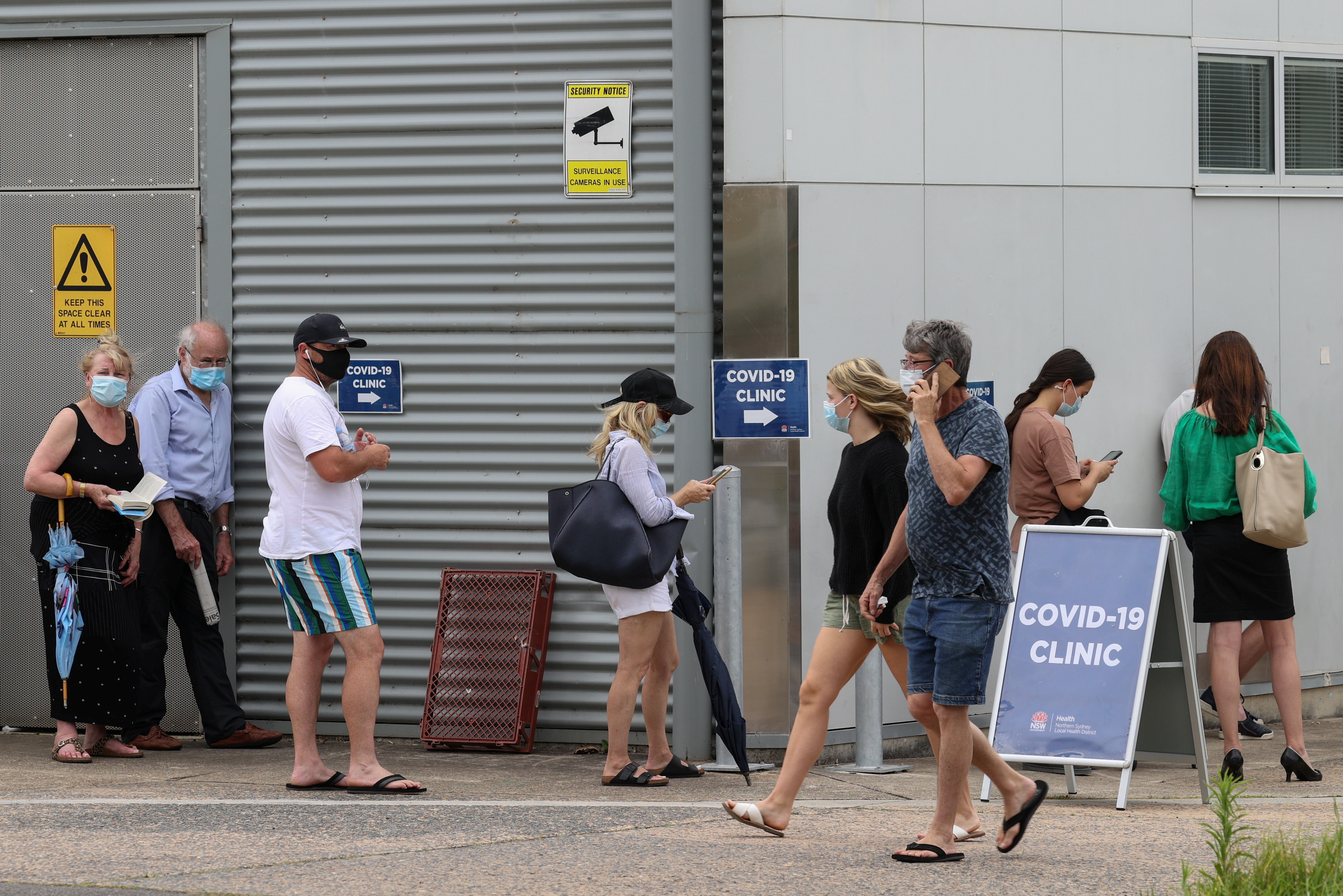 People wait in line at a coronavirus disease (COVID-19) testing clinic at Mona Vale Hospital in the wake of a new outbreak in the Northern Beaches area of Sydney, Australia, December 18, 2020.  REUTERS/Loren Elliott