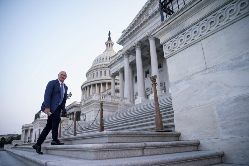 Senator Mark Kelly arrives at the U.S. Capitol to vote as the Senate works to advance the bipartisan infrastructure bill in Washington, U.S., August 8, 2021. REUTERS/Sarah Silbiger/File Photo