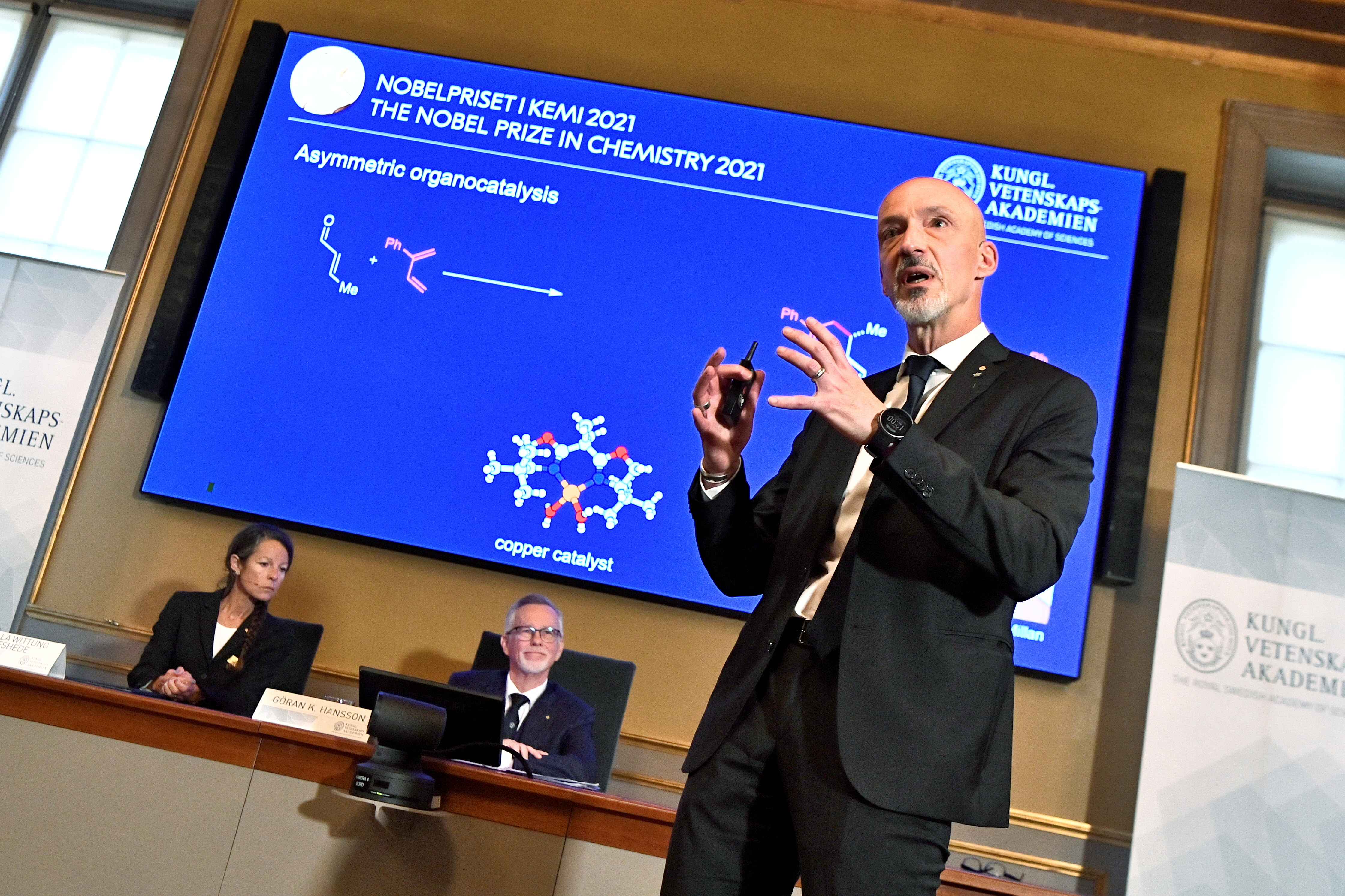 Member of the Nobel Committee for Chemistry Peter Somfai, speaks during the announcement of the 2021 Nobel Prize in Chemistry winners Benjamin List and David MacMillan at the Swedish Academy of Sciences in Stockholm, Sweden October 6, 2021. Claudio Bresciani/TT News Agency/via REUTERS