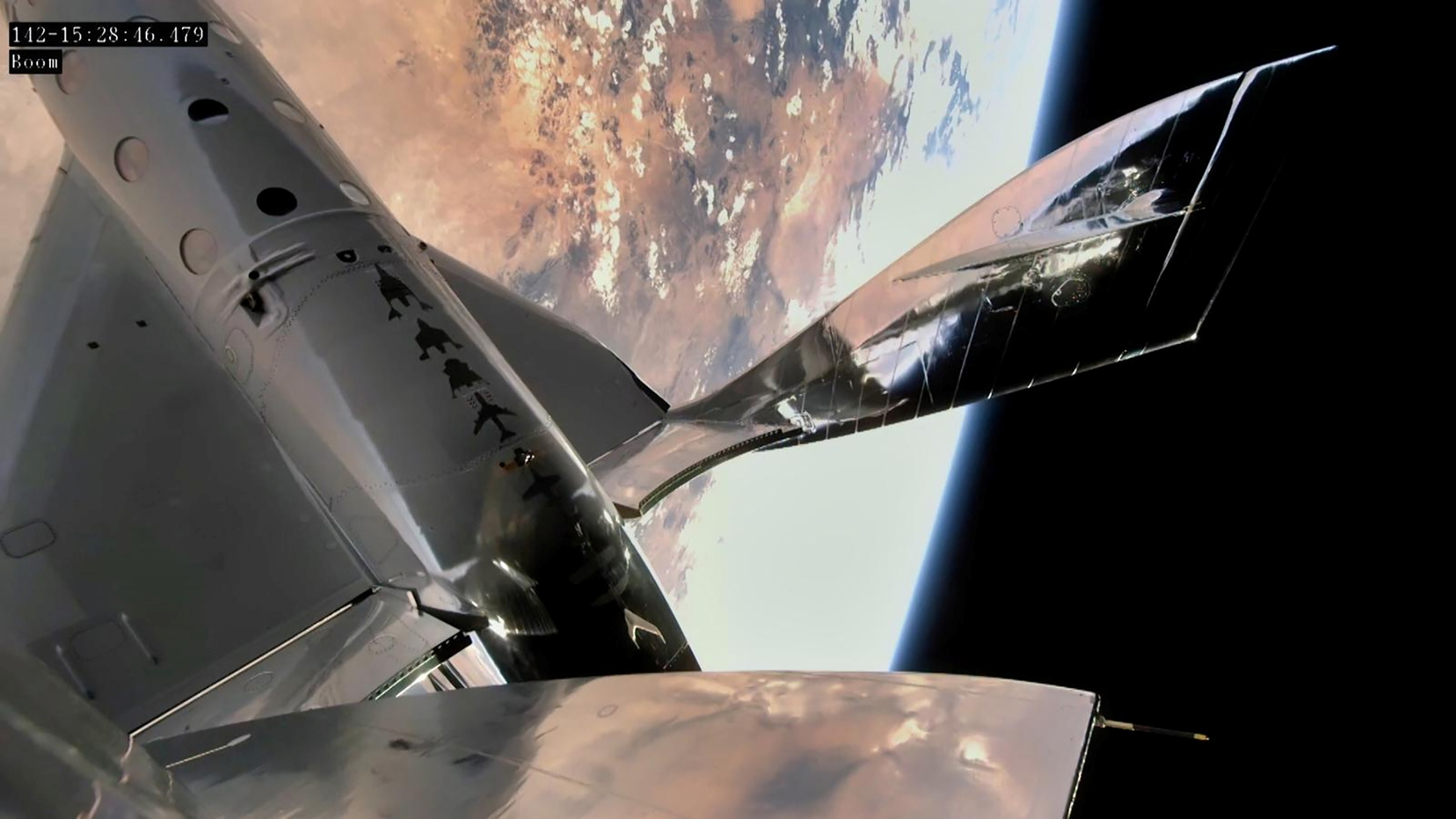 Virgin Galactic's VSS Unity, piloted by CJ Sturckow and Dave Mackay, is seen in a still image from video during its first manned spaceflight after being released from its mothership, VMS Eve, from Spaceport America, New Mexico, U.S. May 22, 2021.  Virgin Galactic/Handout via REUTERS. /File Photo  - U2H6GM7S55OLZB7JJSH6PH7MOY - Virgin Galactic to fly researcher to space for conducting experiments