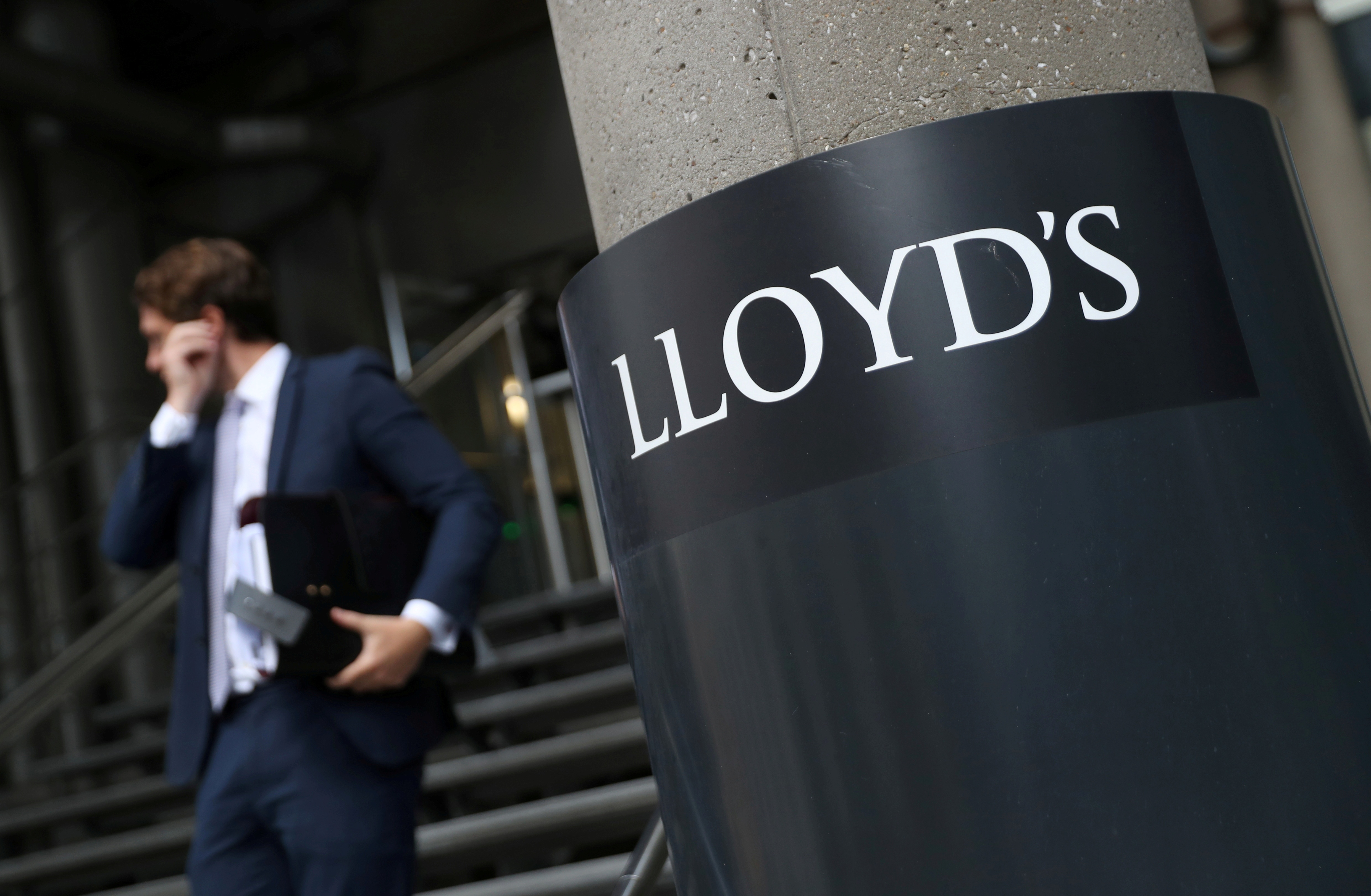 A man walks out of Lloyd's of London's headquarters in the City of London, Britain, July 31, 2018. REUTERS/Simon Dawson/File Photo