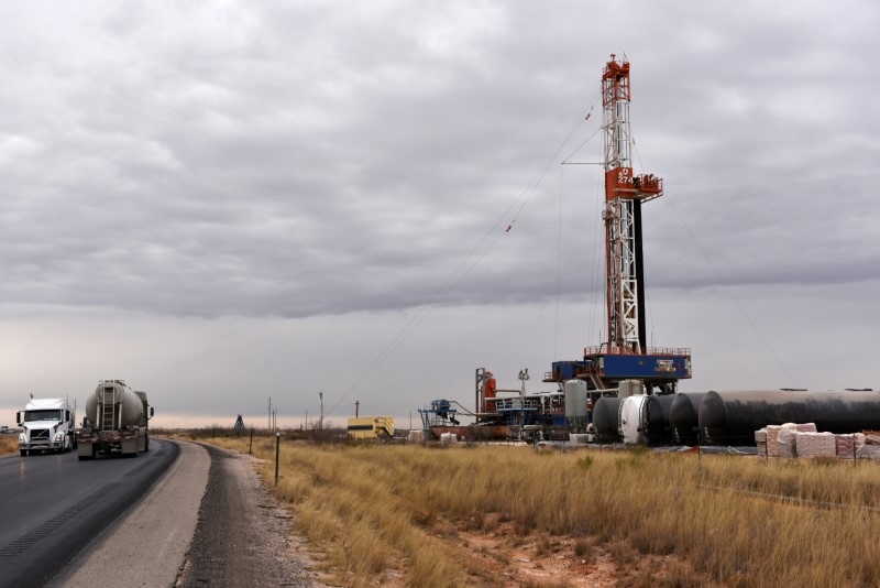 A drilling rig operates in the Permian Basin oil and natural gas production area in Lea County, New Mexico, U.S., February 10, 2019. REUTERS/Nick Oxford