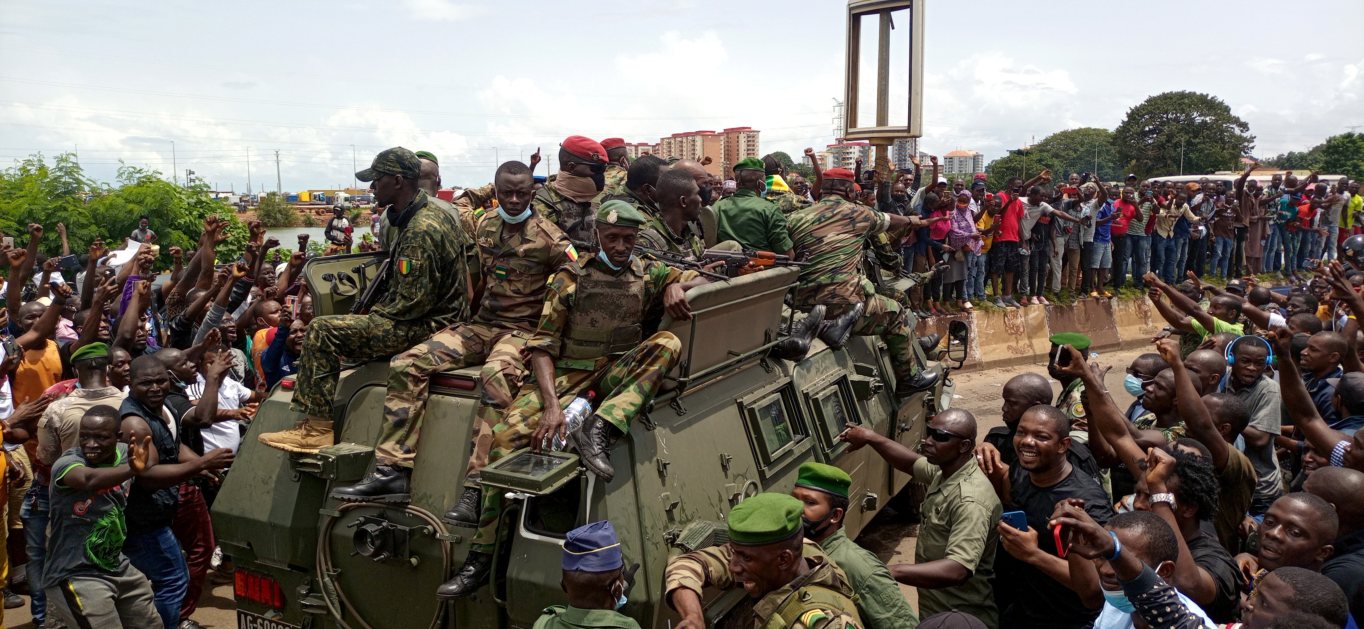 Residents cheer on army soldiers after the uprising that led to the toppling of president Alpha Conde in Kaloum neighbourhood of Conakry, Guinea September 6, 2021 REUTERS/Souleymane Camara