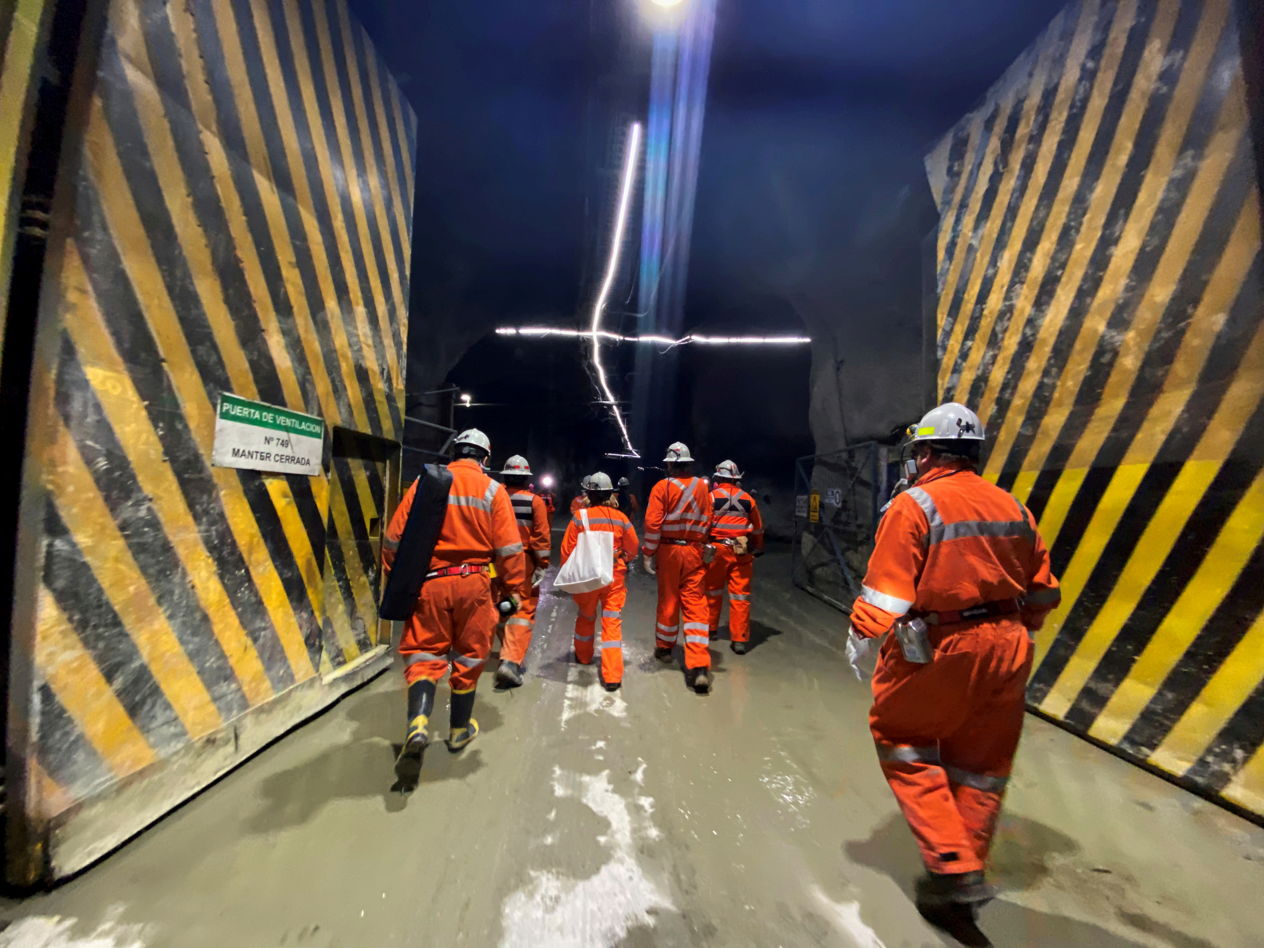 An industry tour group walks inside the Codelco El Teniente copper mine, the world's largest underground copper mine near Machali area, Rancagua, Chile October 15, 2020.
