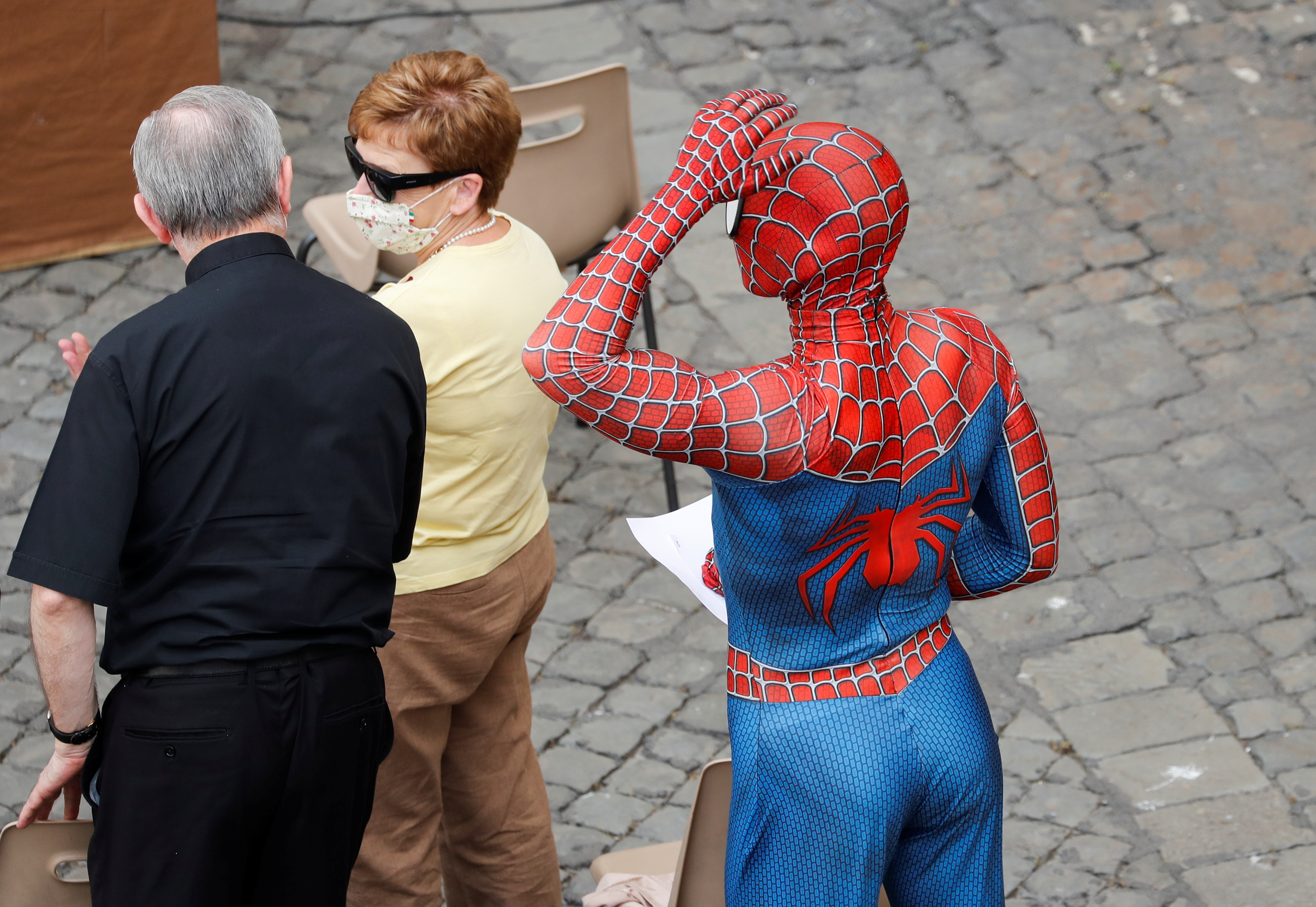 A person dressed as Spiderman stands amongst the faithful listening to Pope Francis at the general audience, amid the coronavirus disease (COVID-19) pandemic, at the Vatican, June 23, 2021. REUTERS/Remo Casilli