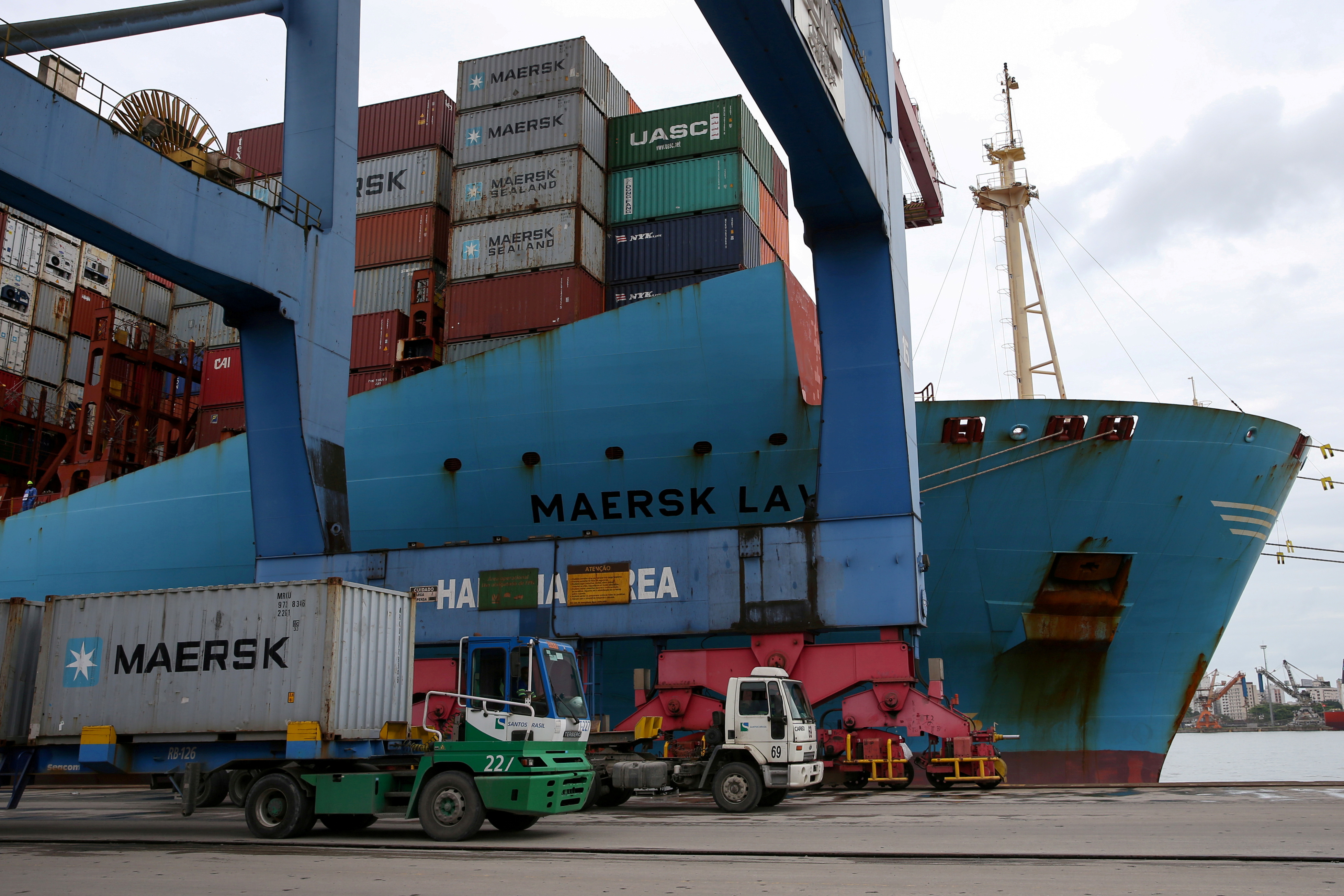 A Maersk ship and containers are seen at the Port of Santos, Brazil,  September 23, 2019. REUTERS/Amanda Perobelli/File Photo