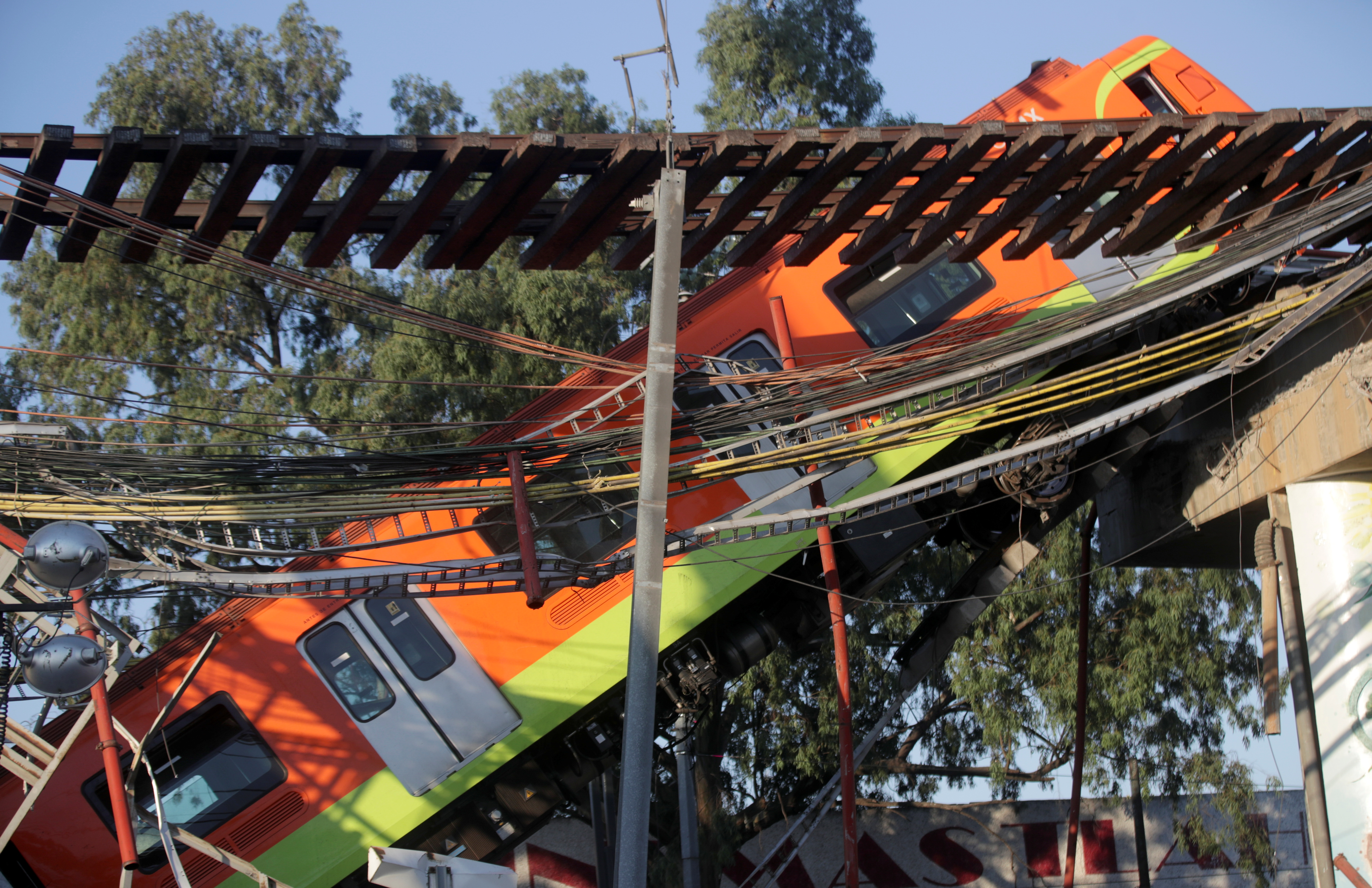 The site where an overpass for a metro partially collapsed with train cars on it is seen at Olivos station in Mexico City, Mexico, May 4, 2021. REUTERS/Henry Romero