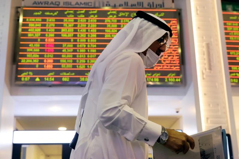 An investor walks through the Dubai Financial Market after Joe Biden won the U.S. presidency, in Dubai, United Arab Emirates November 8, 2020. REUTERS/Christopher Pike