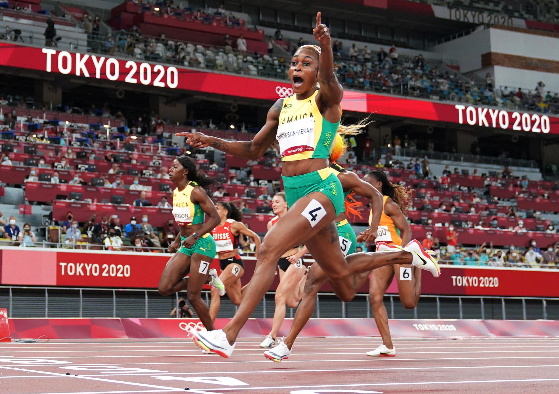 Tokyo 2020 Olympics - Athletics - Women's 100m - Final - OLS - Olympic Stadium, Tokyo, Japan - July 31, 2021. Elaine Thompson-Herah of Jamaica crosses the finish line first to win the gold medal REUTERS/Pawel Kopczynski