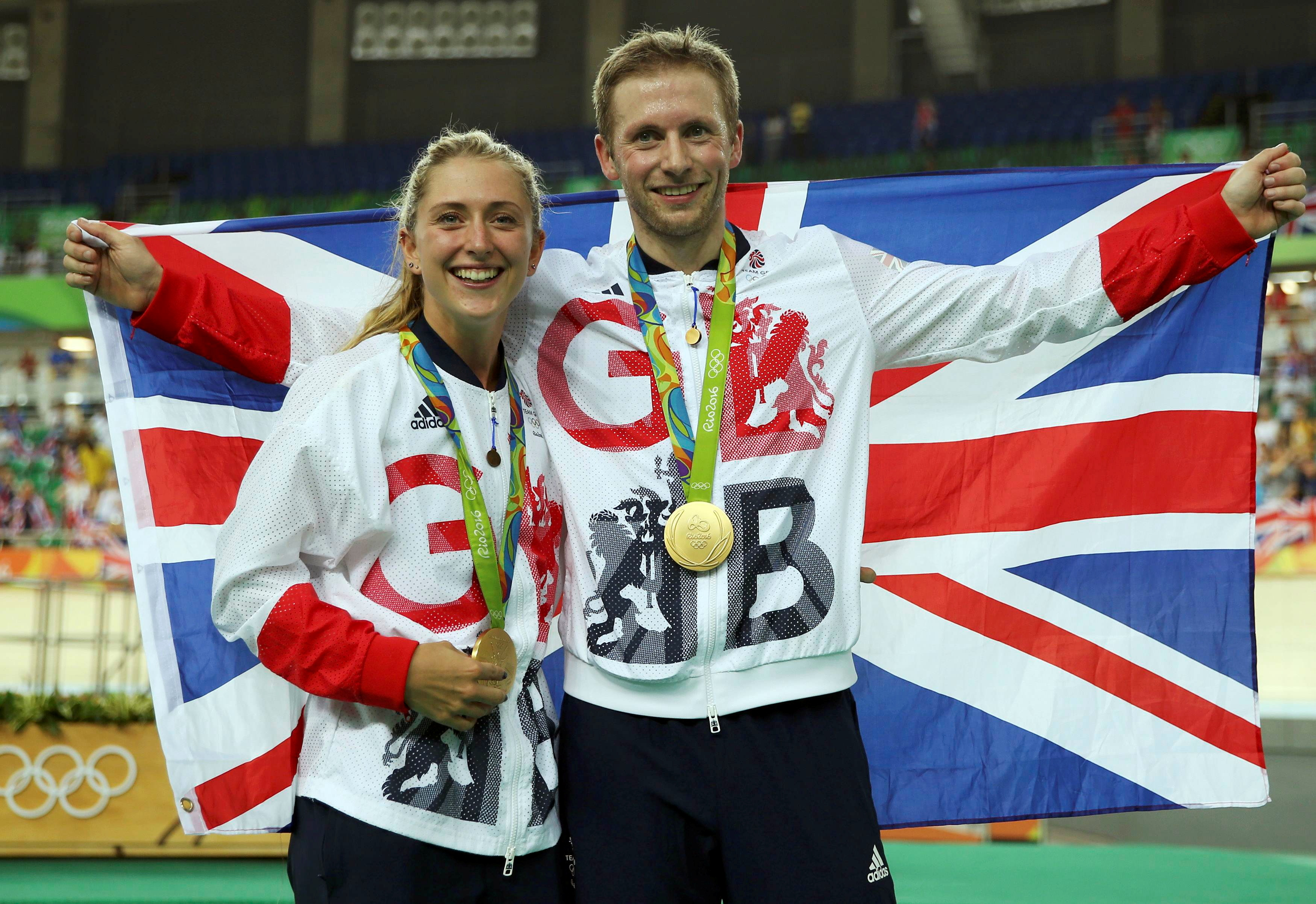 2016 Rio Olympics - Cycling Track - Victory Ceremony - Men's Keirin Victory Ceremony - Rio Olympic Velodrome - Rio de Janeiro, Brazil - 16/08/2016. Gold medalist Jason Kenny (GBR) of Britain poses with his gilfriend, women's omnium gold medalist Laura Trott (GBR) of Britain.   REUTERS/Matthew Childs FOR EDITORIAL USE ONLY. NOT FOR SALE FOR MARKETING OR ADVERTISING CAMPAIGNS./File Photo