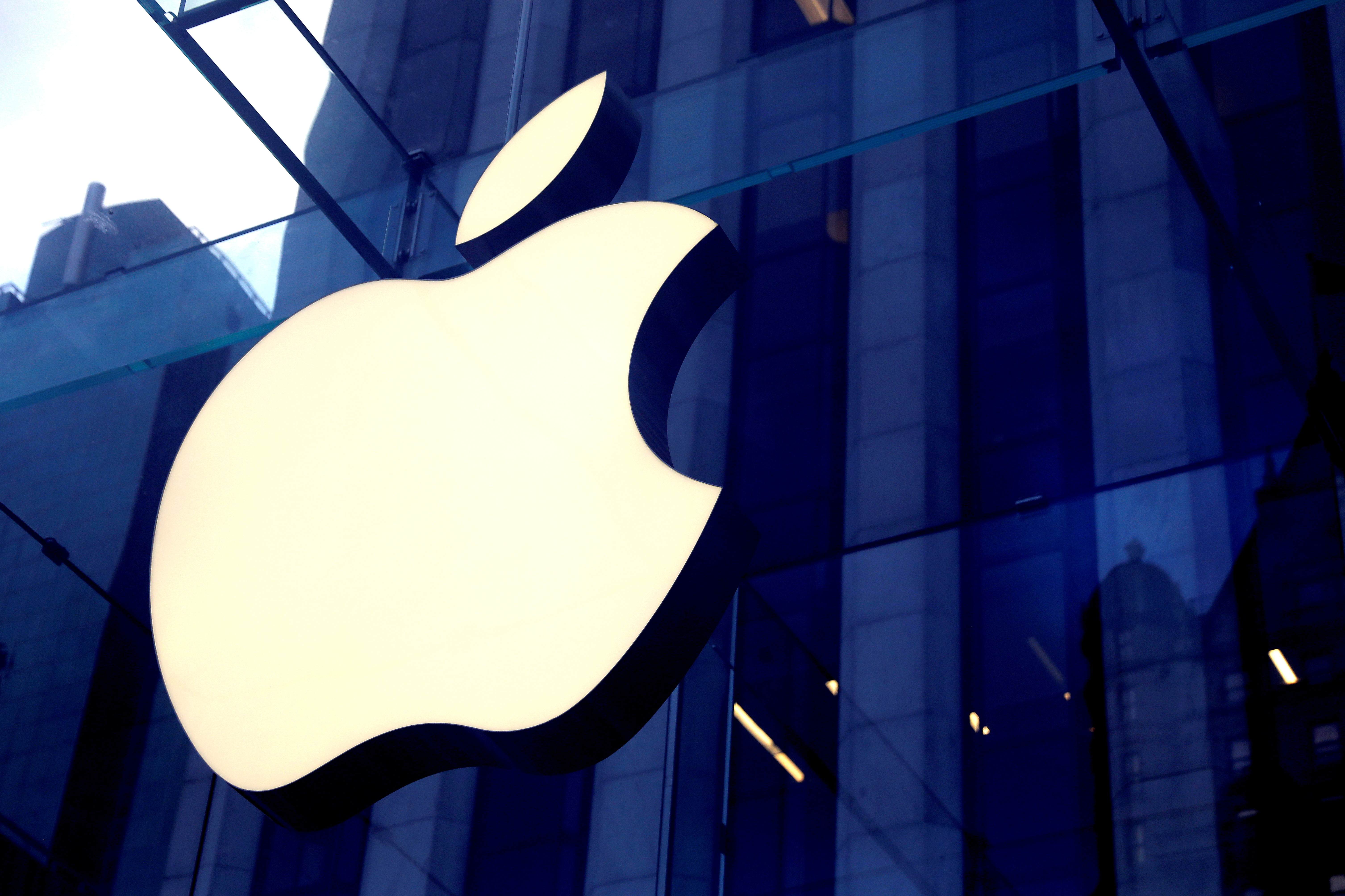 The Apple Inc logo is seen hanging at the entrance to the Apple store on 5th Avenue in Manhattan, New York, U.S., October 16, 2019. REUTERS/Mike Segar